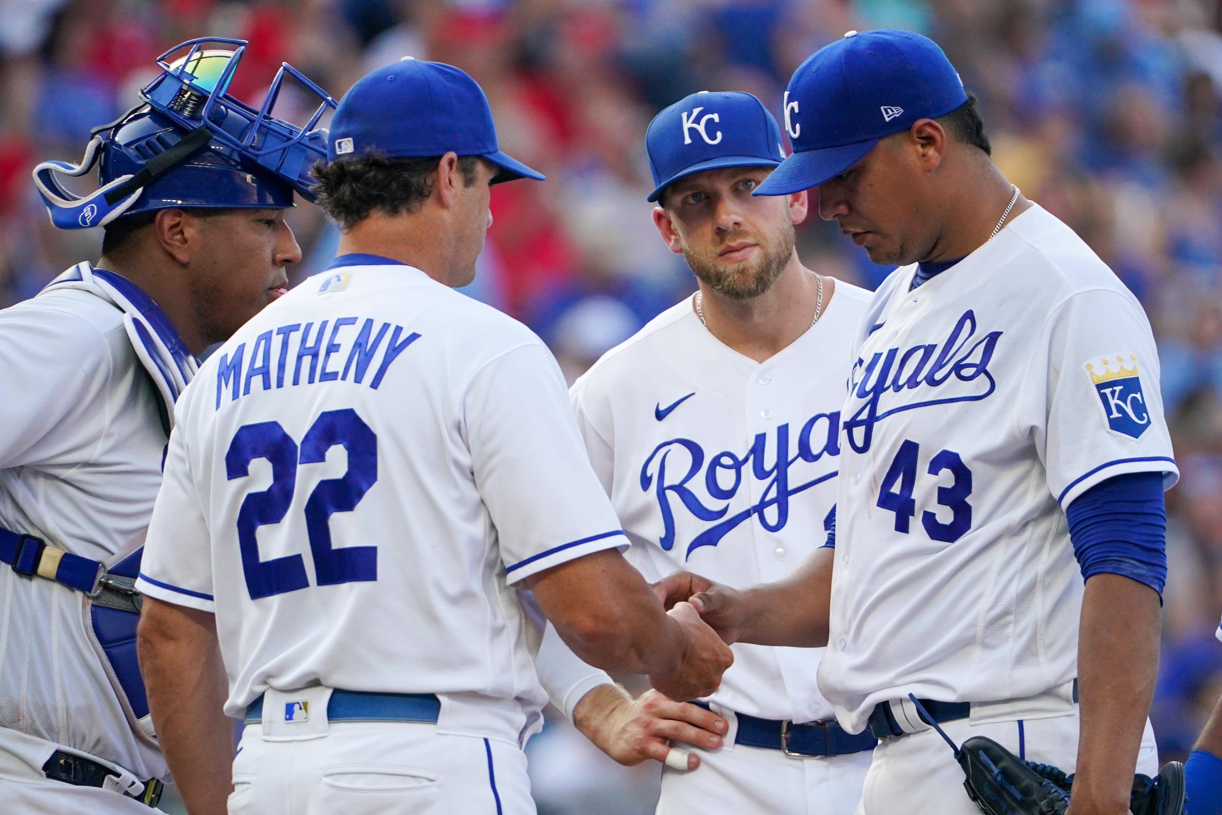Kansas City Royals manager Mike Matheny (22) comes to the mound to replace starting pitcher Carlos Hernandez (43) in the fourth inning against the Detroit Tigers at Kauffman Stadium.