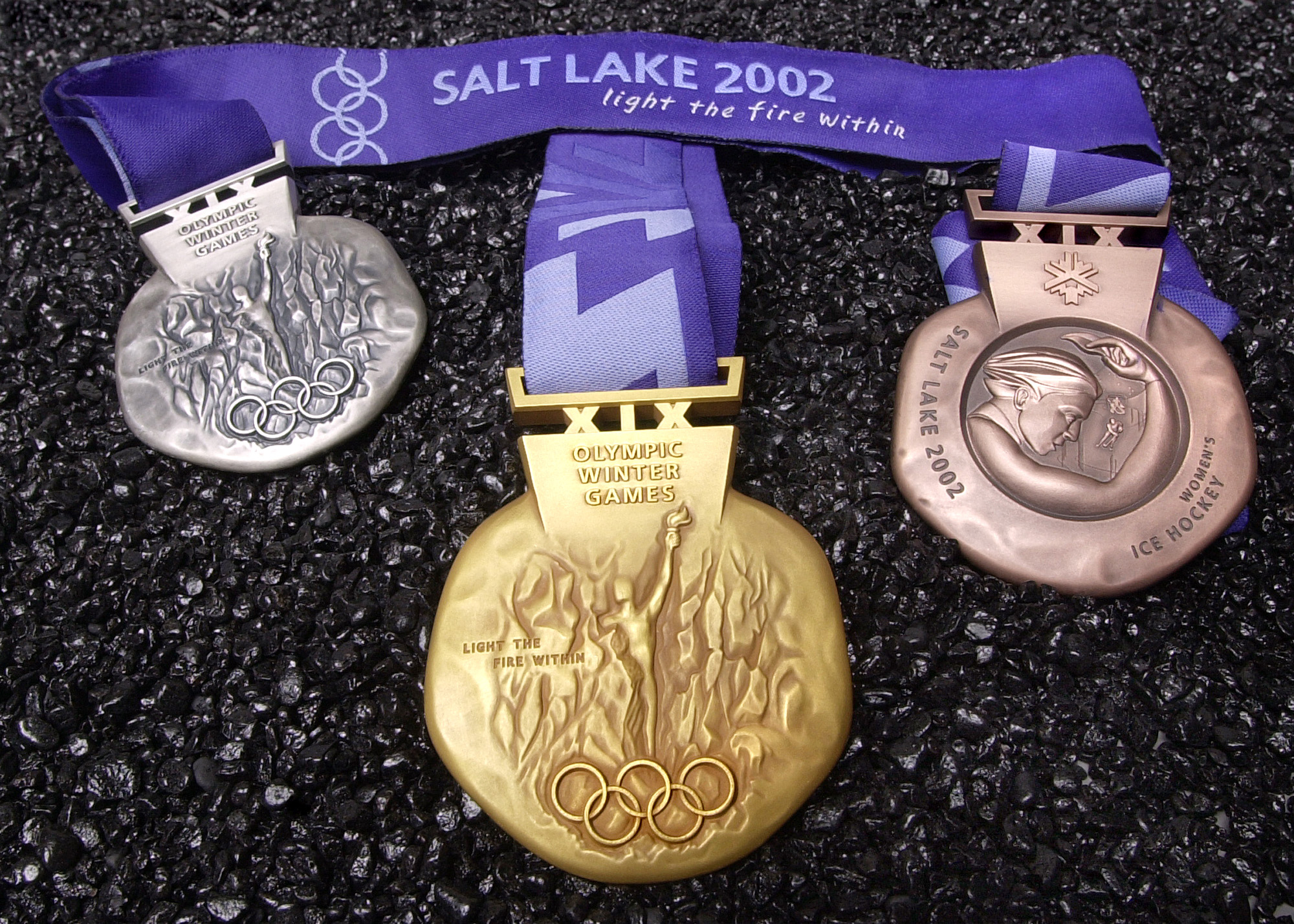 Olympics medals for the 2002 Winter Games are shown. Utah is bidding to host the Olympics once more.