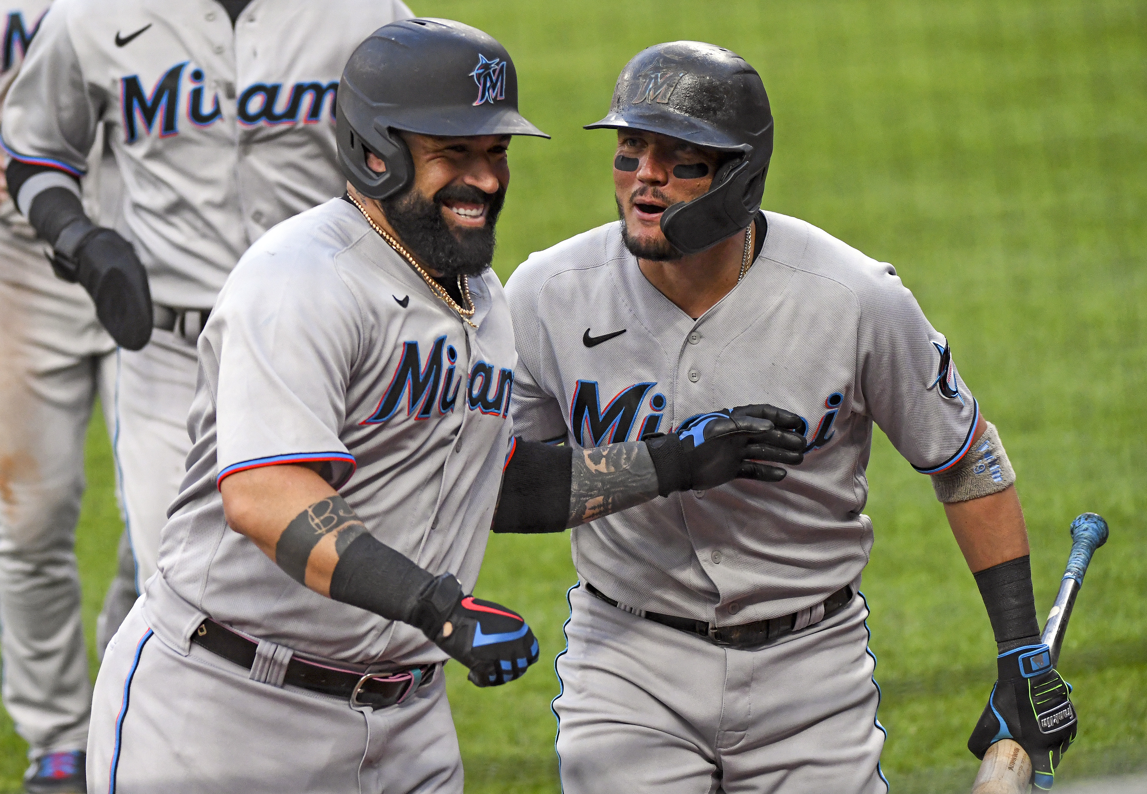 Miami Marlins catcher Sandy Leon (7) is congratulated by shortstop Miguel Rojas (19) after hitting a three run home run in the second inning during the Miami Marlins game versus the Baltimore Orioles