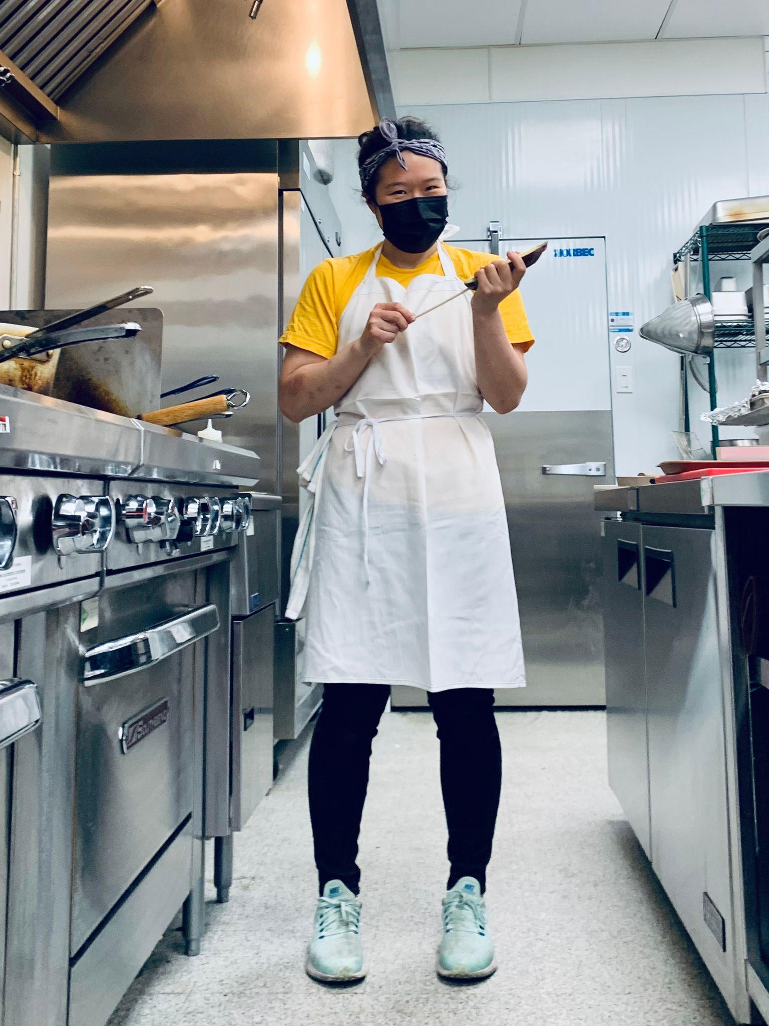 women in kitchen wear an apron