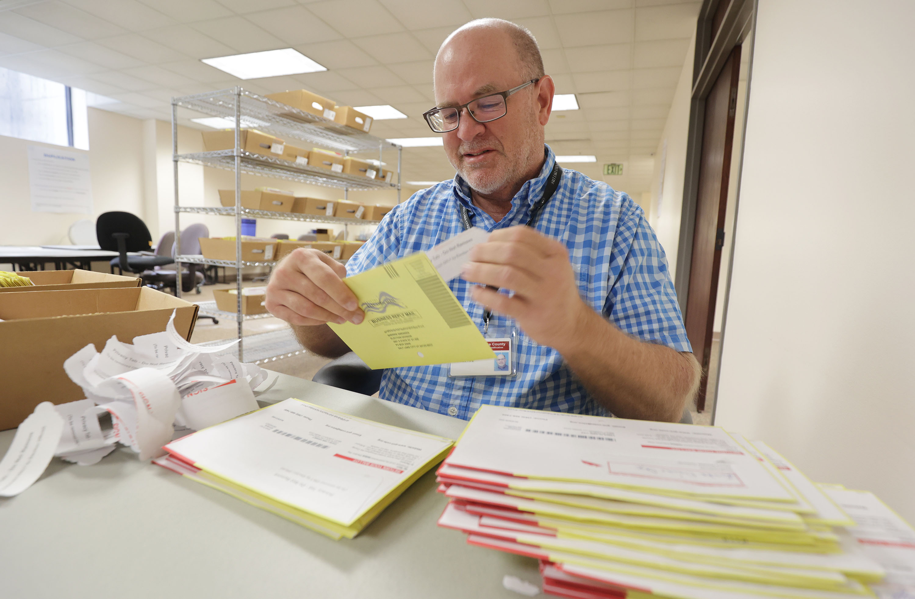 Salt Lake County Election Coordinator Michael Fife tabs returned ballots at the Salt Lake County Government Center in Salt Lake City on Wednesday, July 28, 2021.
