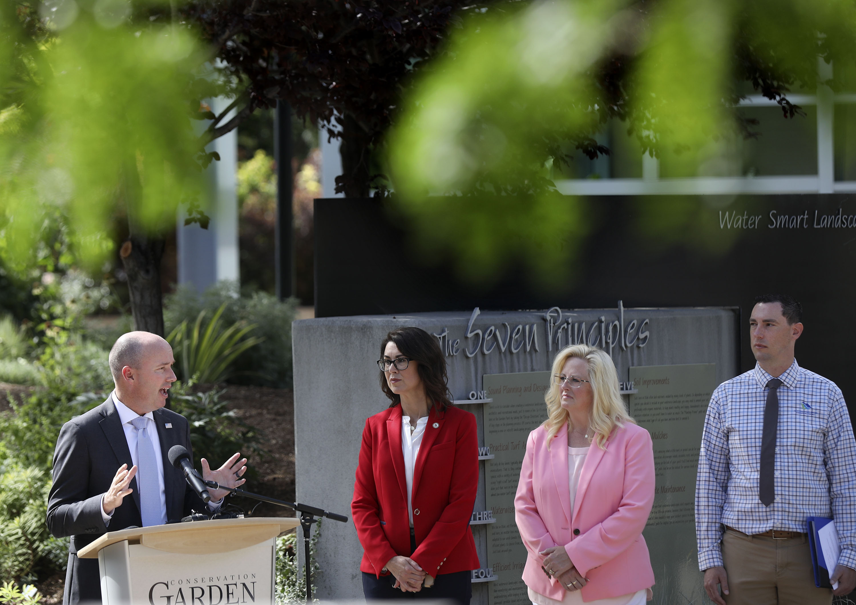 Gov. Spencer Cox speaks about water conservation as Lt. Gov. Deidre Henderson, South Jordan Mayor Dawn Ramsey and Central Utah Water Conservation District manager Rick Maloy participate in a press conference.