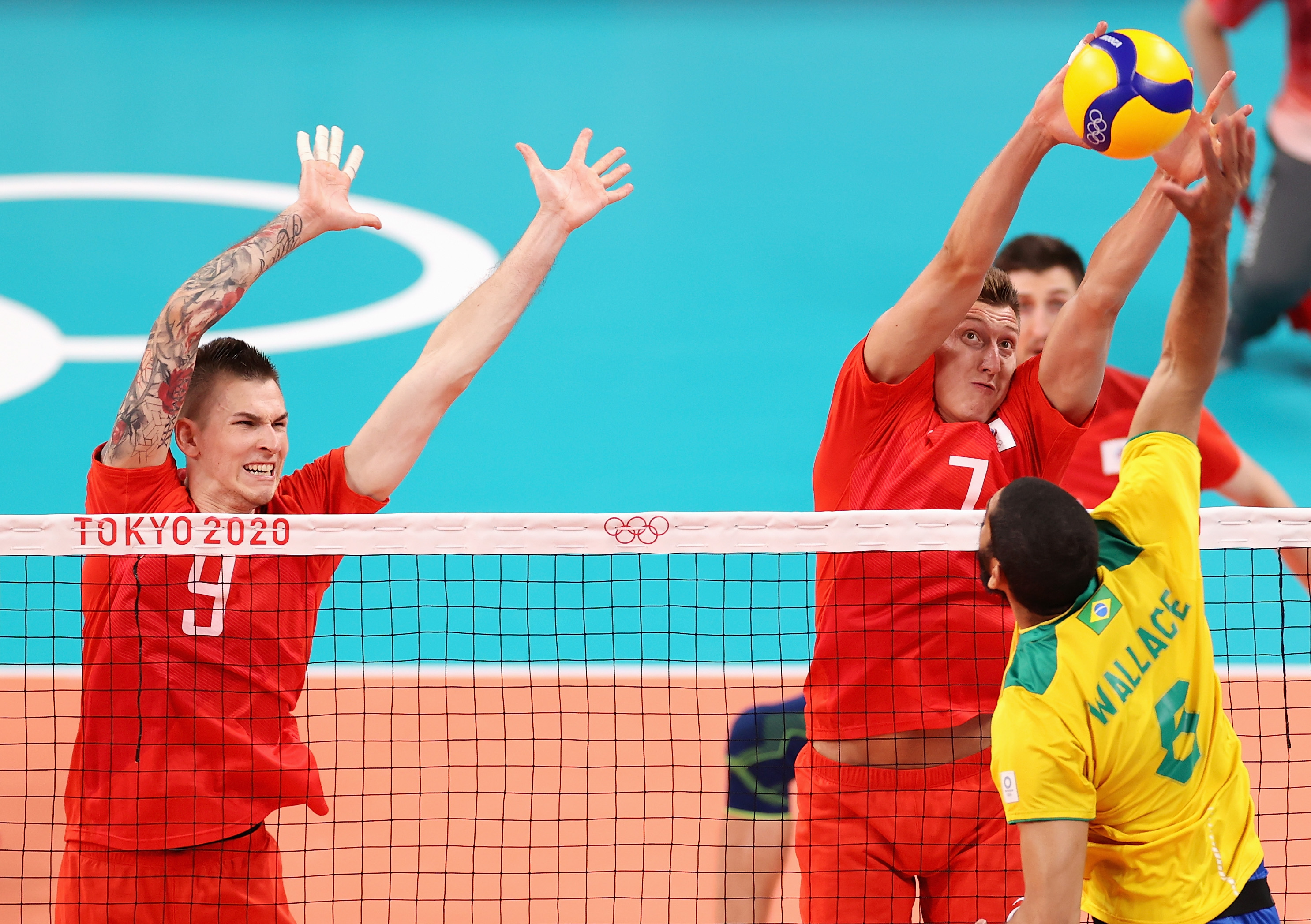 Wallace de Souza #8 of Team Brazil competes against Ivan Iakovlev #9 and Dmitry Volkov #7 of Team ROC during the Men's Preliminary Round - Pool B volleyball on day five of the Tokyo 2020 Olympic Games at Ariake Arena on July 28, 2021 in Tokyo, Japan.