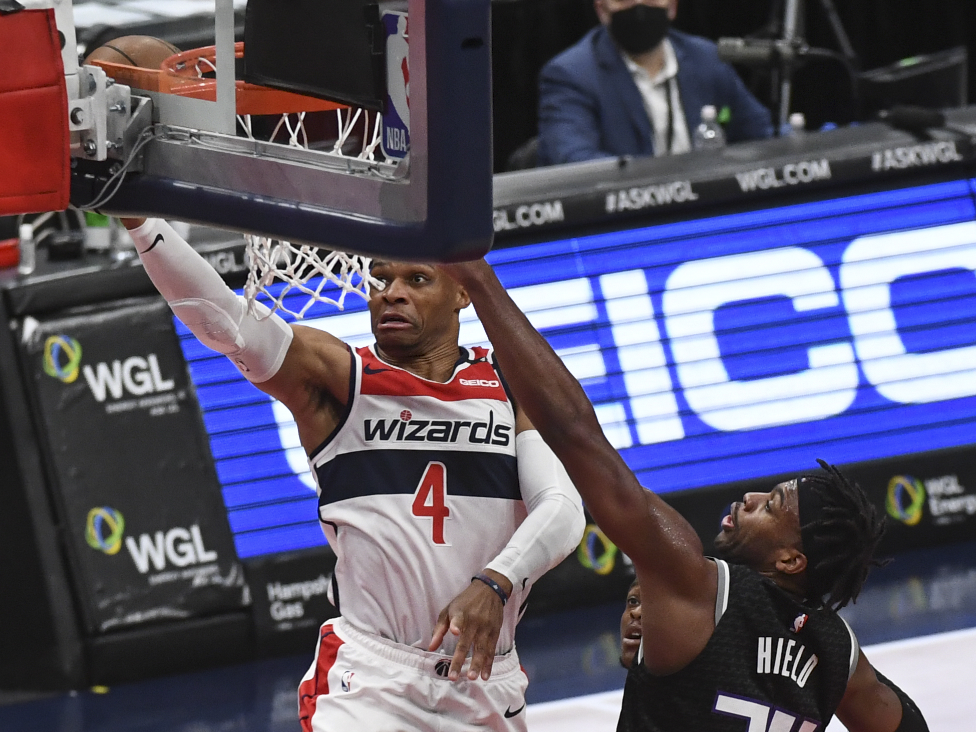 Washington Wizards guard Russell Westbrook (4) beasts Sacramento Kings guard Buddy Hield (24) as he goes up for two during the first quarter of the game between the Washington Wizards and the Sacramento Kings on Wednesday, March 16, 2021.