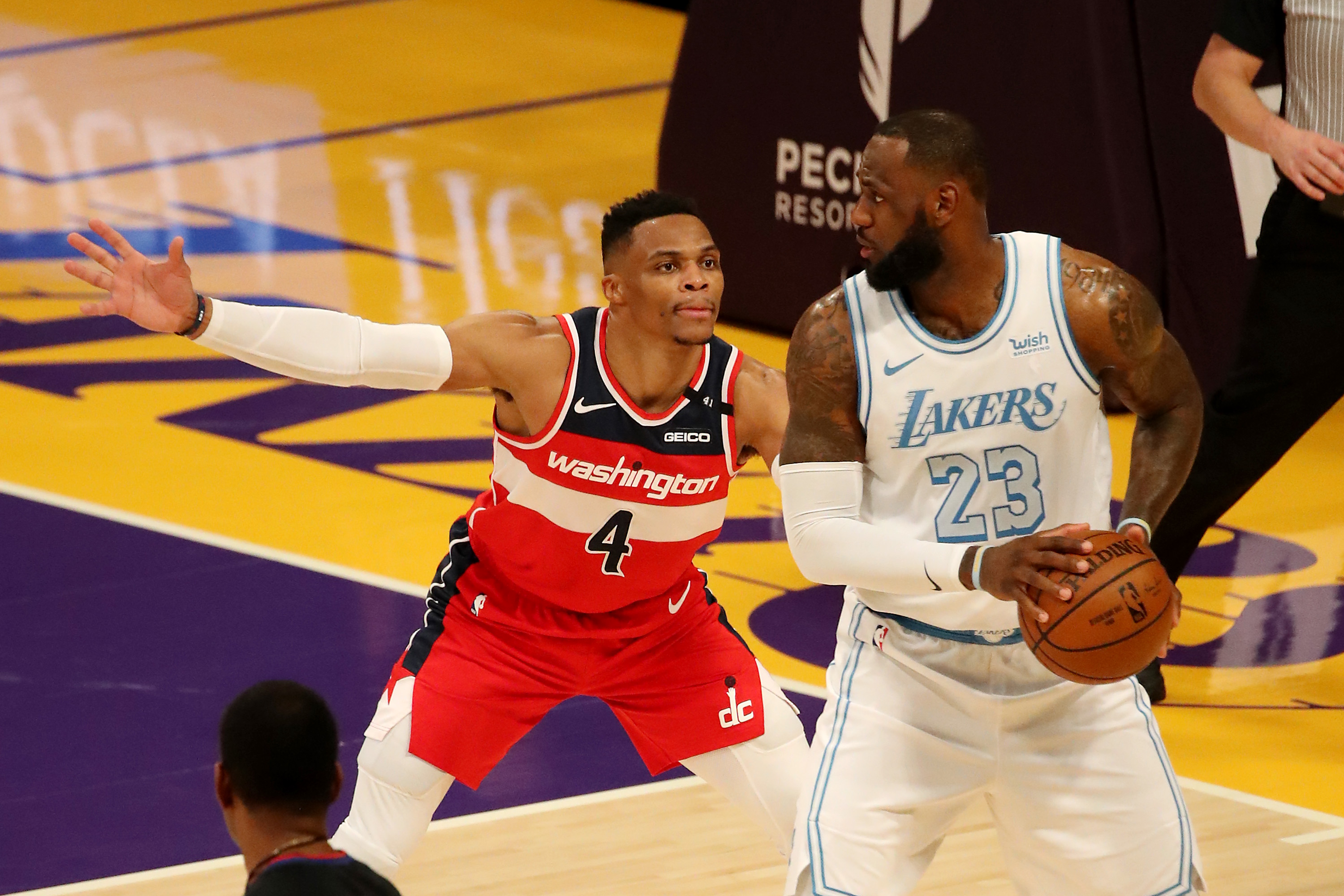 Russell Westbrook #4 of the Washington Wizards guards LeBron James #23 of the Los Angeles Lakers during the fourth quarter at Staples Center on February 22, 2021 in Los Angeles, California.