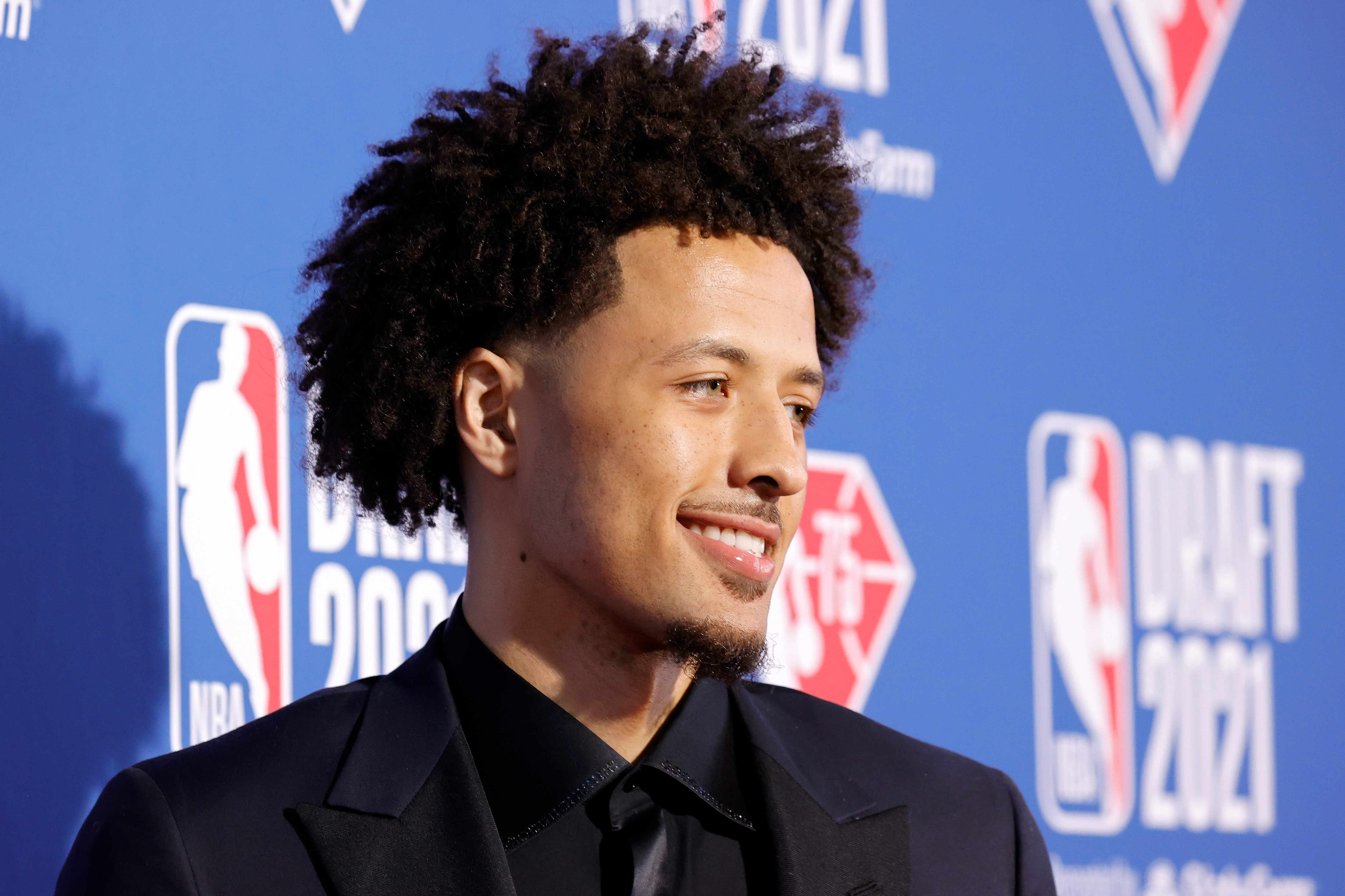 Cade Cunningham poses for photos on the red carpet during the 2021 NBA Draft at the Barclays Center on July 29, 2021 in New York City.