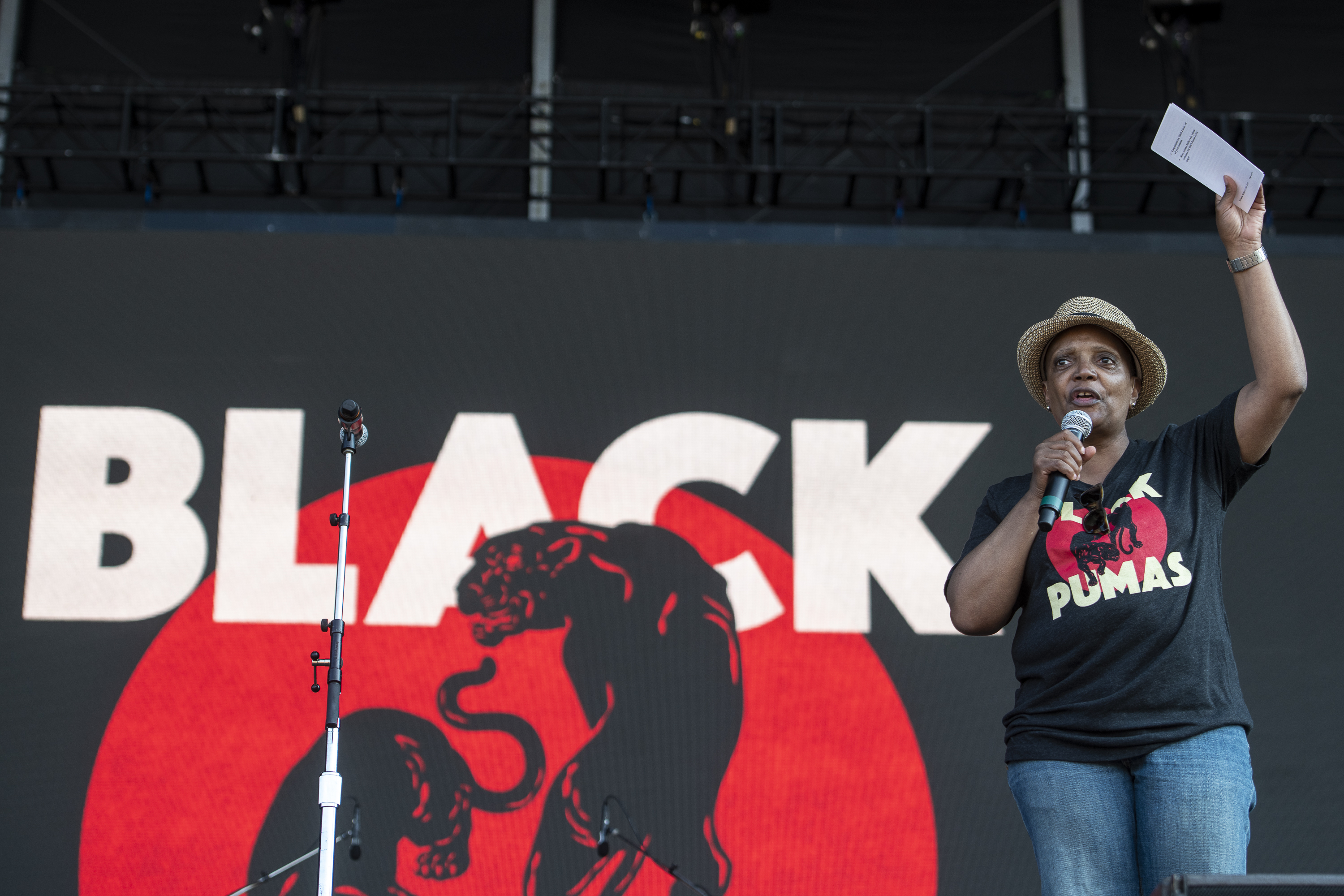 Wearing a Black Pumas T-shirt, Mayor Lori Lightfoot introduces the band on Day One of Lollapalooza in Grant Park.