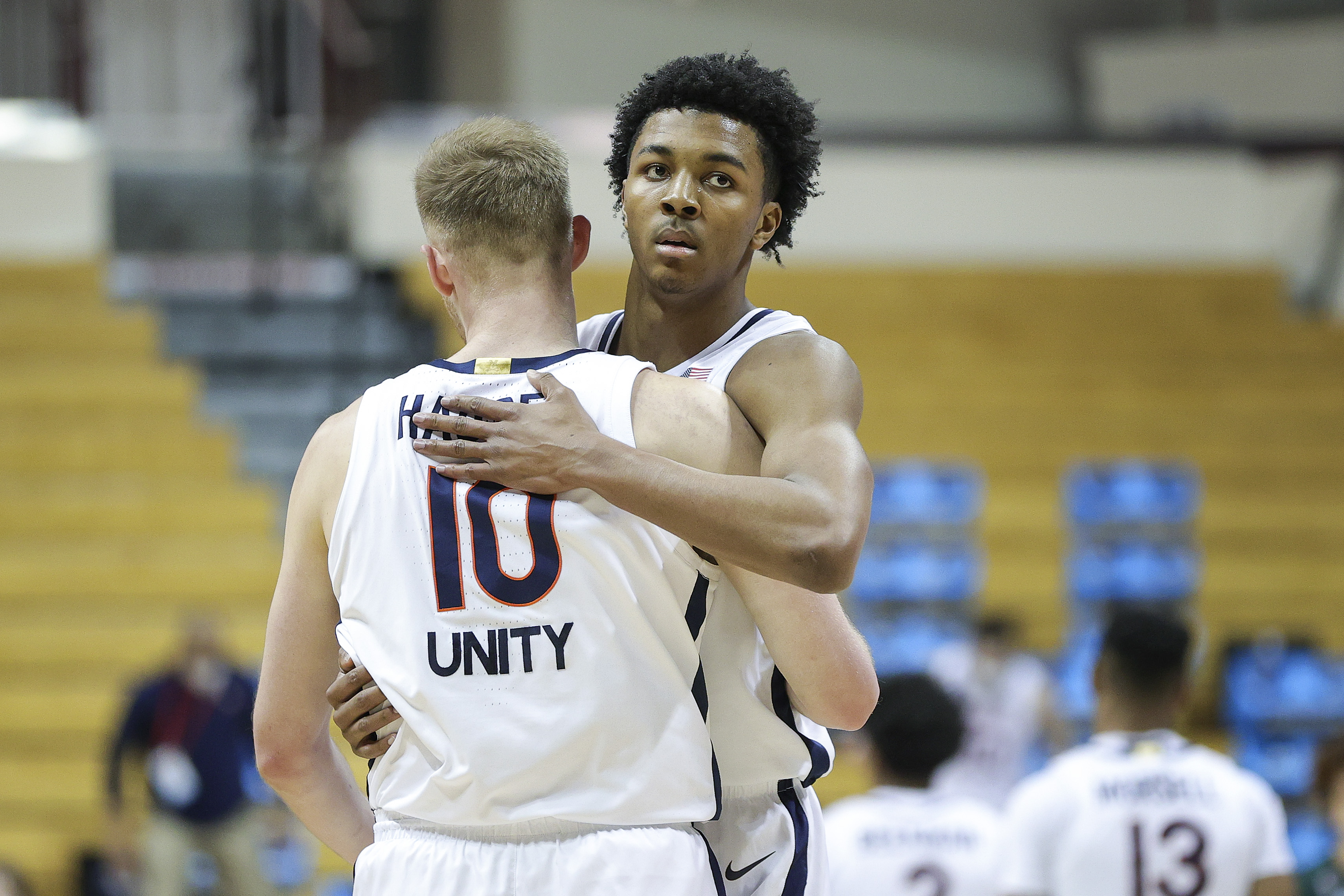 Sam Hauser and Trey Murphy III of the Virginia Cavaliers celebrate a basket against the Ohio Bobcats in the first round game of the 2021 NCAA Men's Basketball Tournament at Assembly Hall on March 20, 2021 in Bloomington, Indiana.