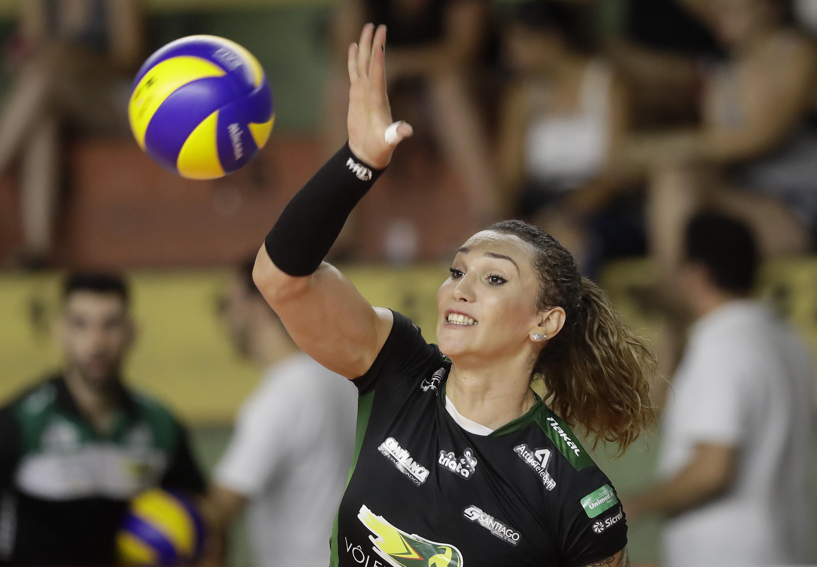Tiffany Abreu spikes the ball during a Brazilian volleyball league match in Bauru, Brazil, Tuesday, Dec. 19, 2017.