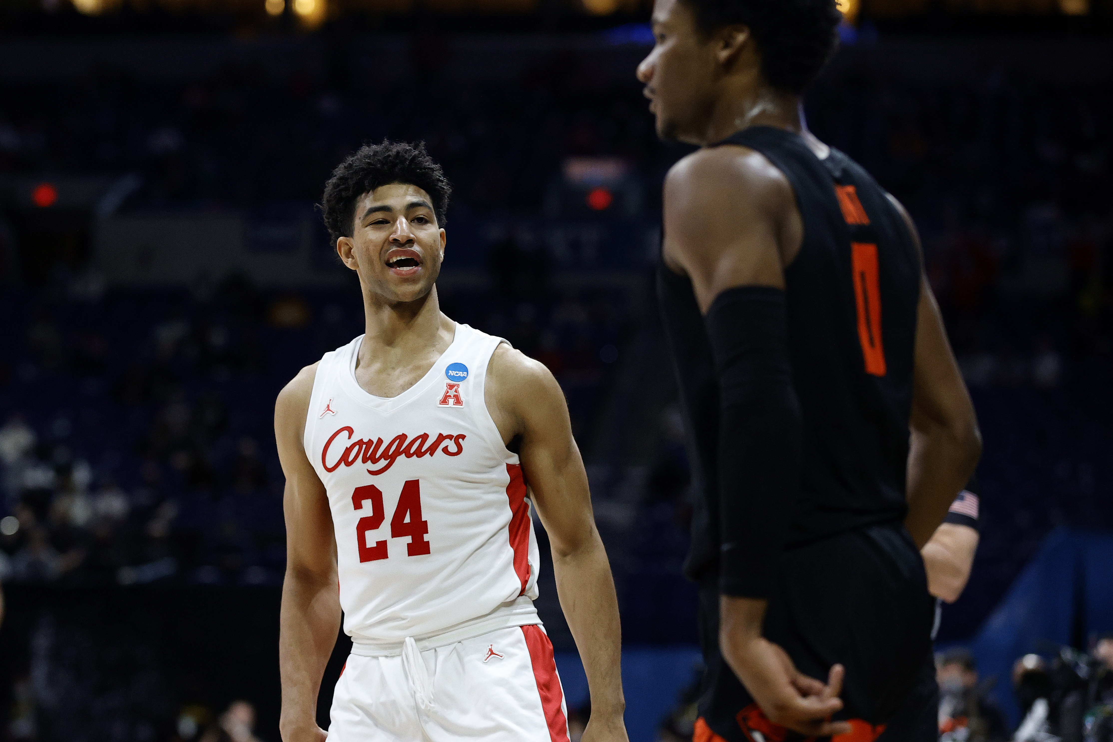 Quentin Grimes of the Houston Cougars speaks to Gianni Hunt of the Oregon State Beavers after making a three point basket during the second half in the Elite Eight round of the 2021 NCAA Men's Basketball Tournament at Lucas Oil Stadium on March 29, 2021 in Indianapolis, Indiana.