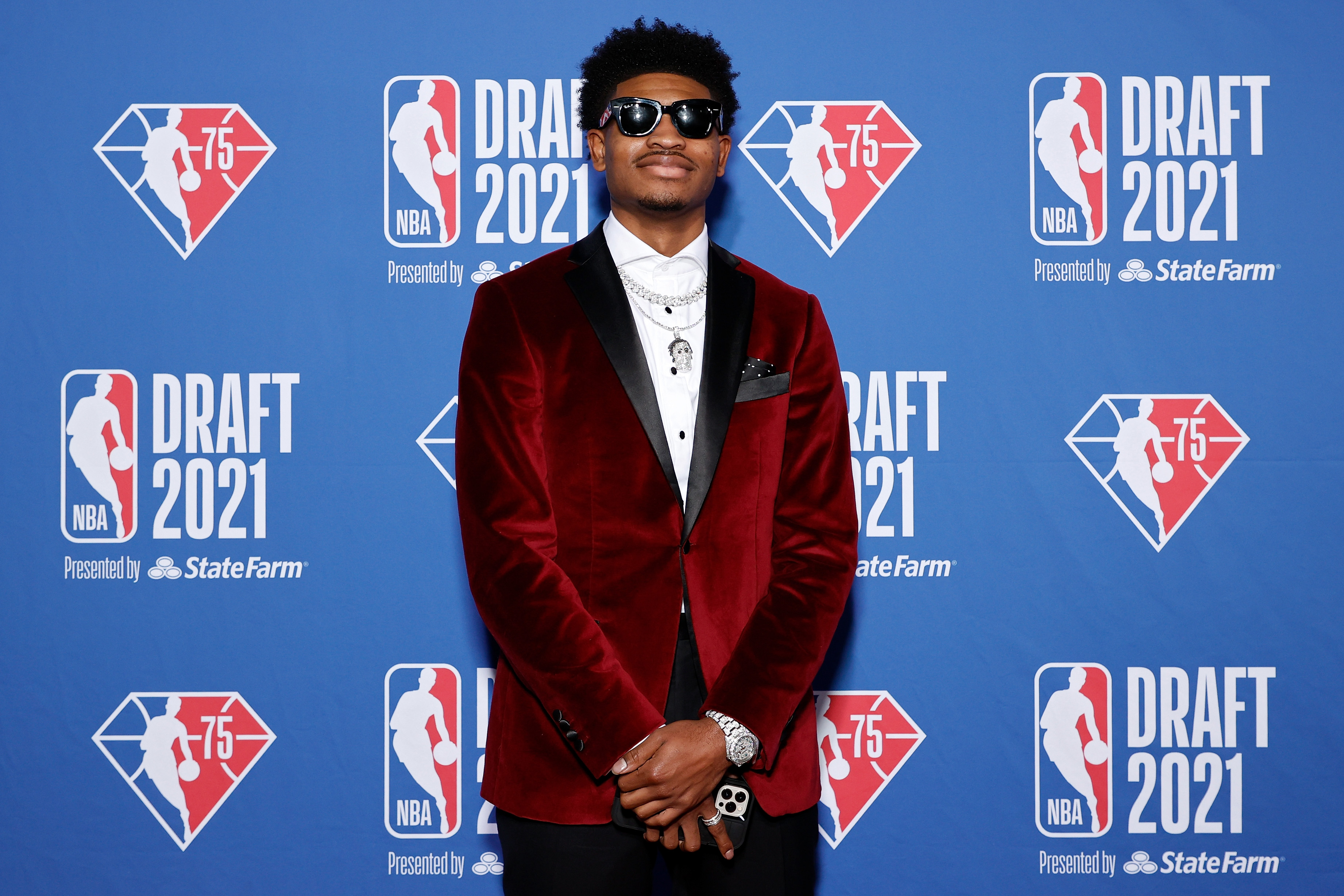 Cam Thomas poses for photos on the red carpet during the 2021 NBA Draft at the Barclays Center on July 29, 2021 in New York City.