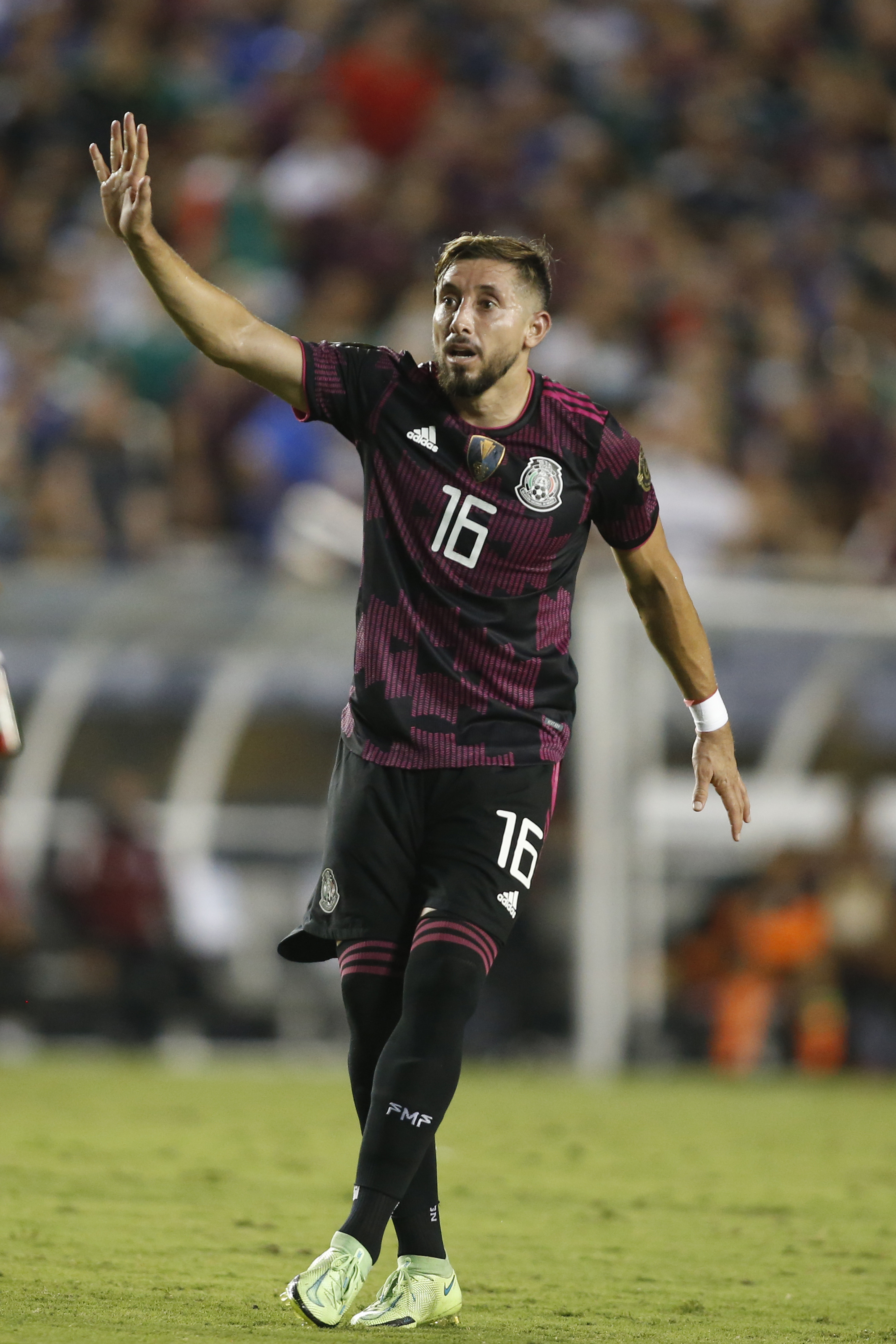 Mexico midfielder Hector Herrera reacts during the second half against El Salvador during CONCACAF Gold Cup Soccer group stage play at Cotton Bowl.