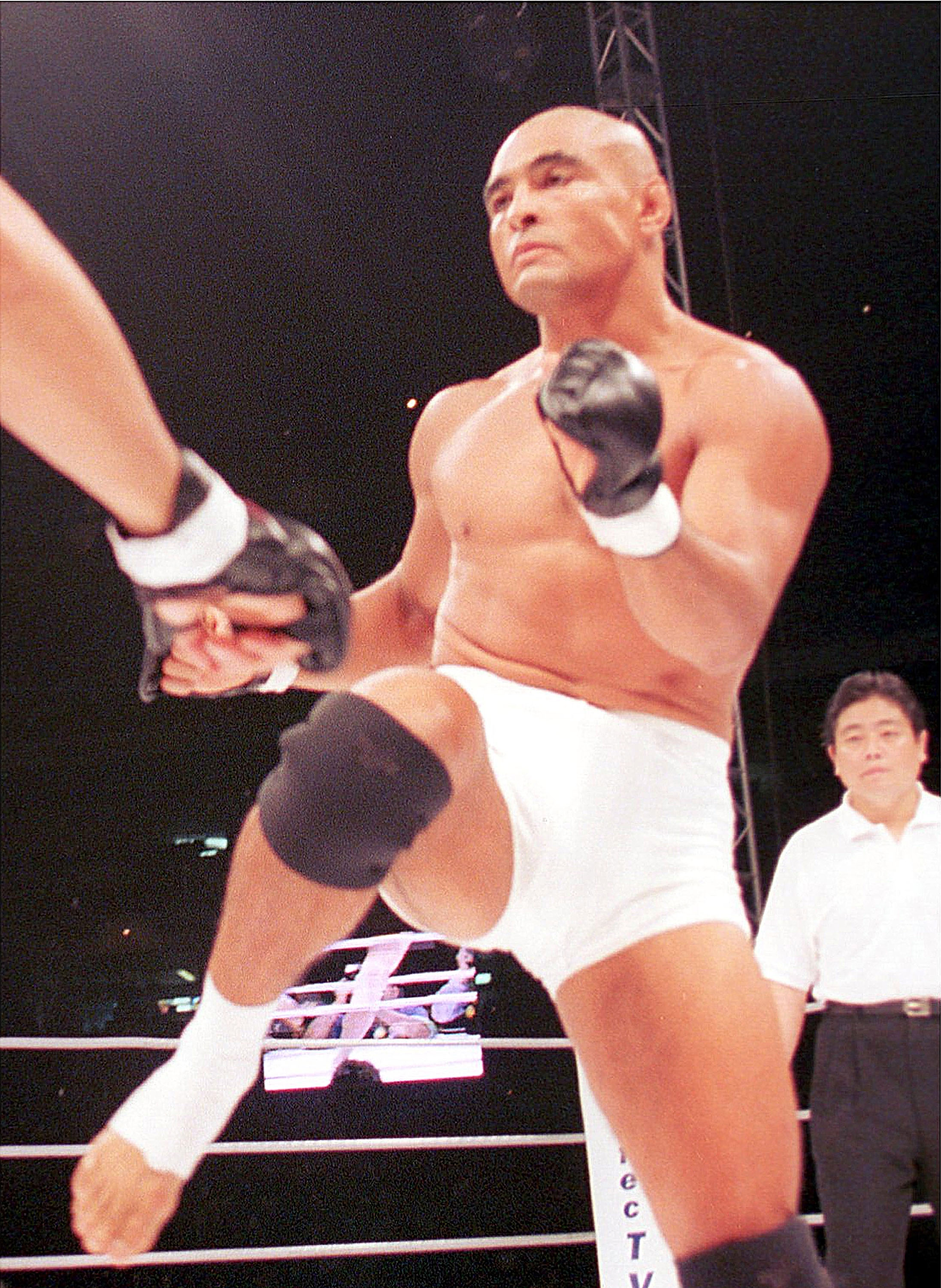 TOKYO, JAPAN - MAY 26: (JAPANESE NEWSPAPERS OUT) Rickson Gracie competes in the match against Masakatsu Funaki during the Colosseum 2000 at Tokyo Dome on May 26, 2000 in Tokyo, Japan.