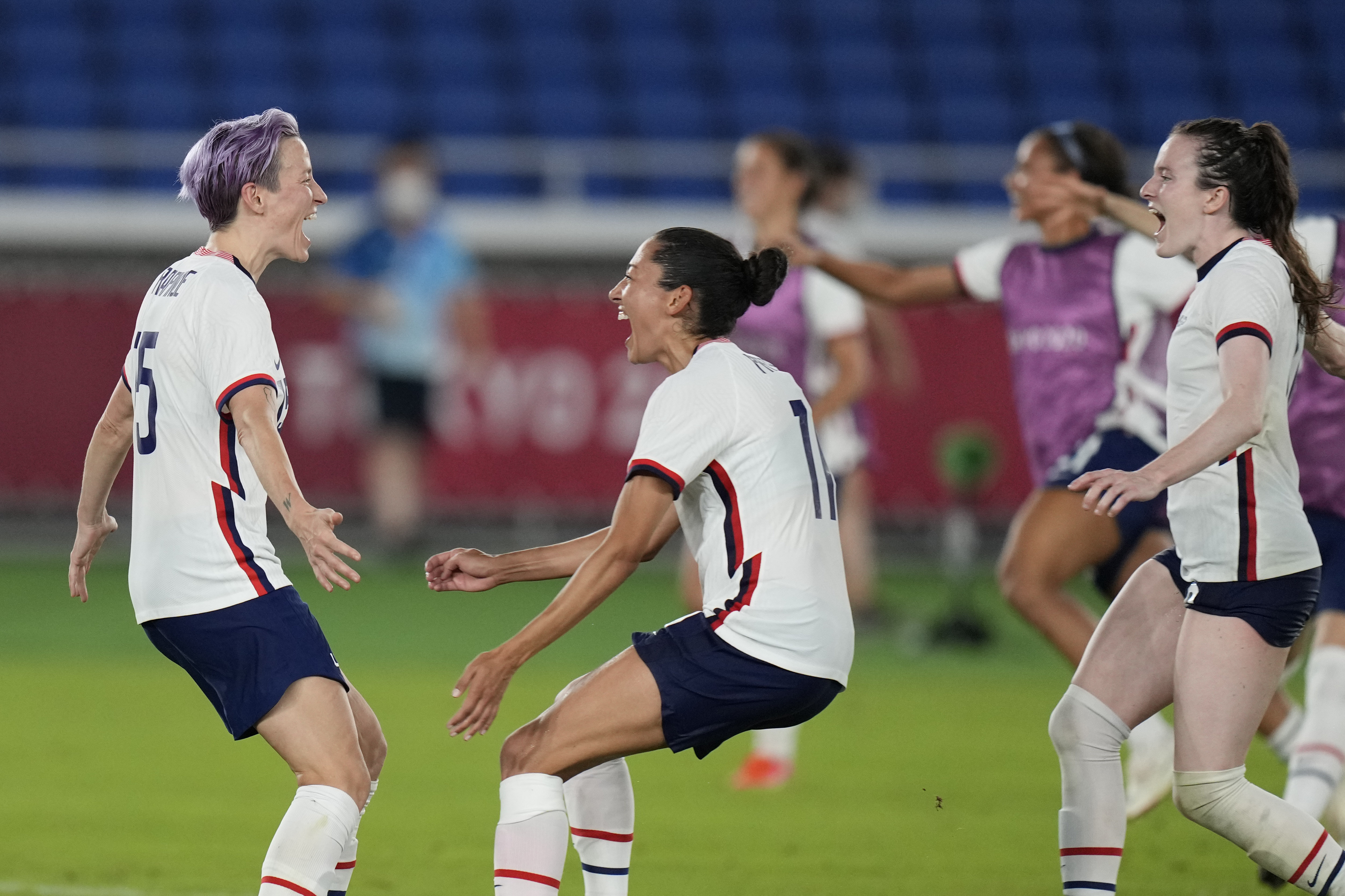 United States' Megan Rapinoe, left, celebrates with teammates after scoring the winning goal and defeating the Netherlands in a penalty shootout.