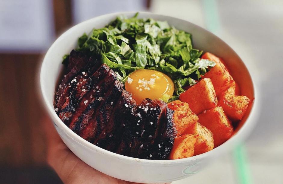 A closeup of Revel's short rib bowl with sambal daikon and mustard greens.