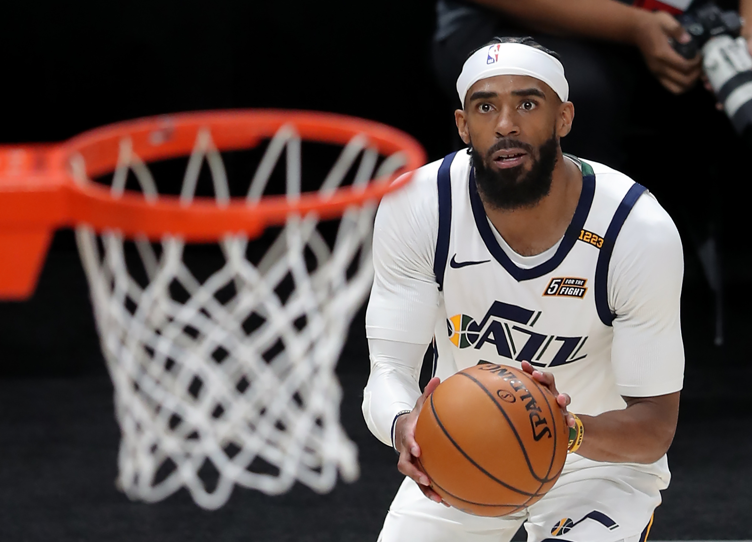 Utah Jazz guard Mike Conley eyes the basket as he goes up for and hits a 3-point shot.