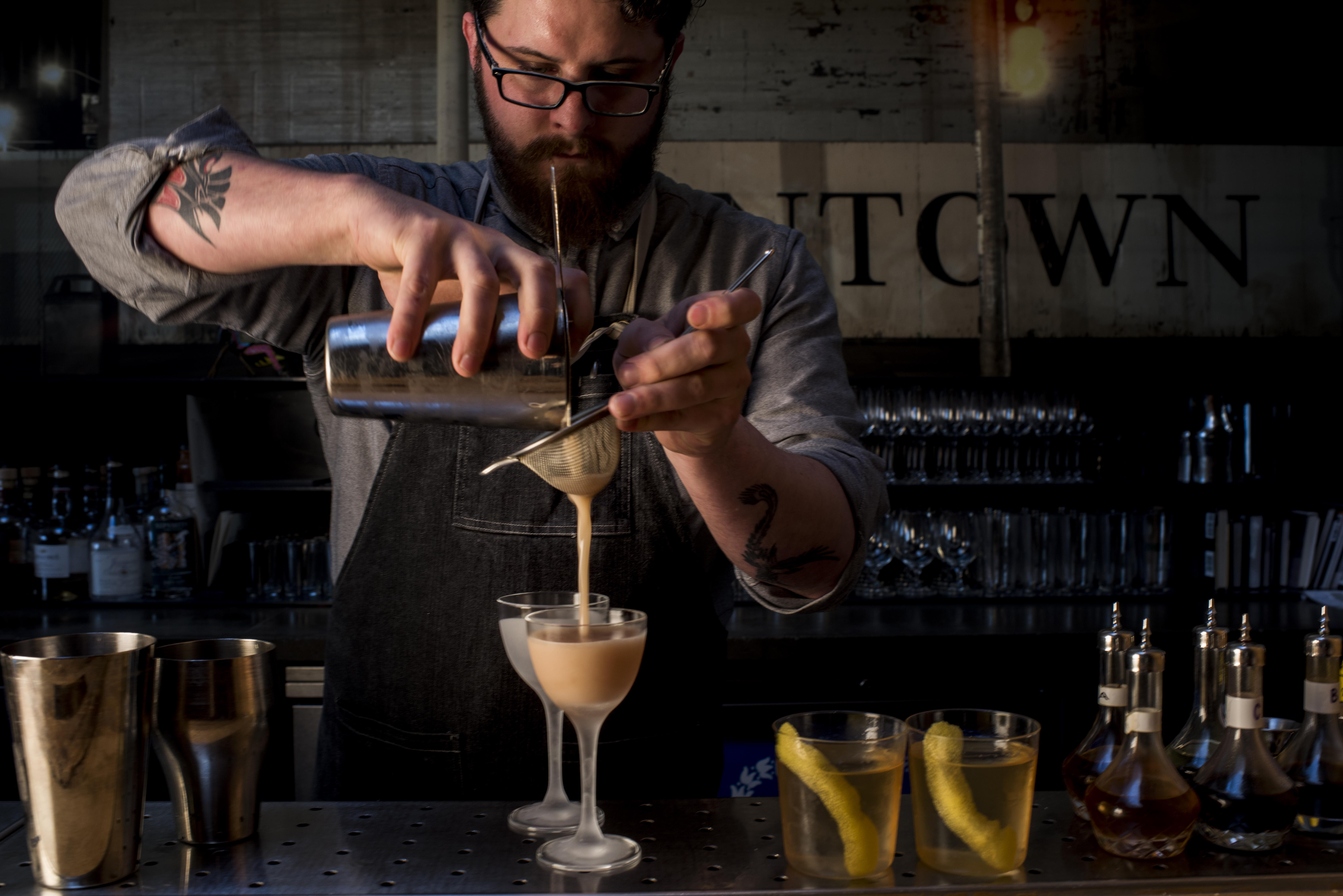 Bartender Evan Williams creates Brandy Daisy with colleagues at Bar Agricole in San Francisco, California Wednesday, April 8, 2015.