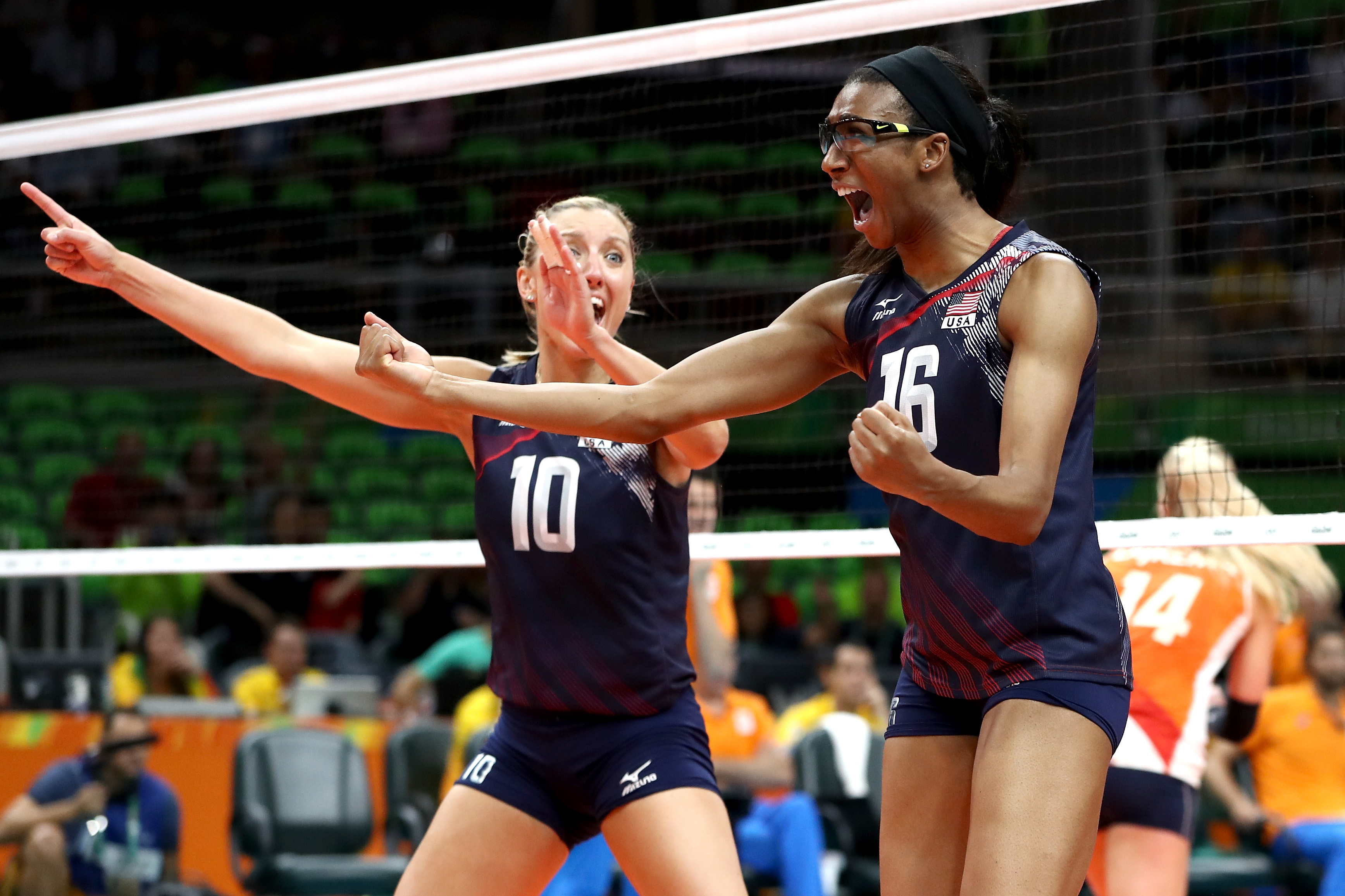Jordan Larson, Foluke Akinradewo of United States celebrate winning match point during the Women's Bronze Medal Match between Netherlands and the United States on Day 15 of the Rio 2016 Olympic Games at the Maracanazinho on August 20, 2016 in Rio de Janeiro, Brazil.