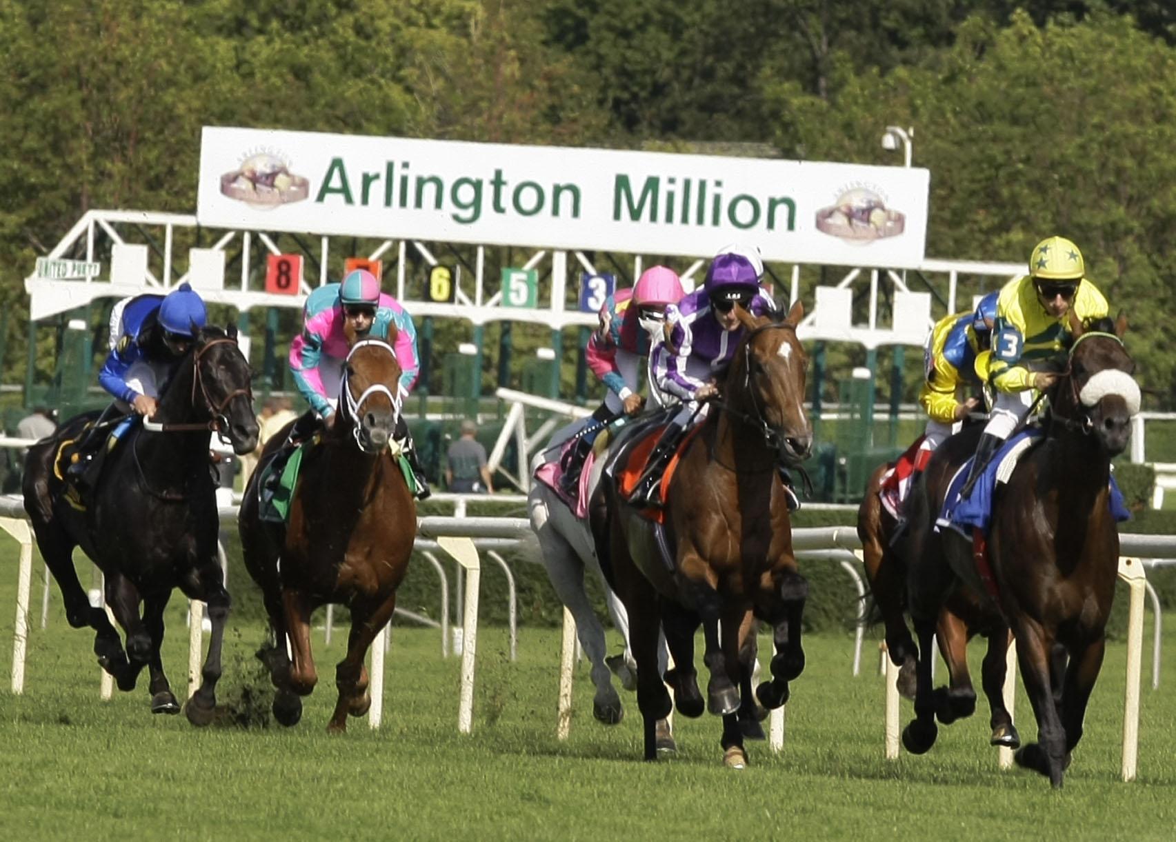 Spirit One, right, from France, ridden by Loritz Mendizabal, leads the Arlington Million pack at Arlington International Racecourse in 2008.