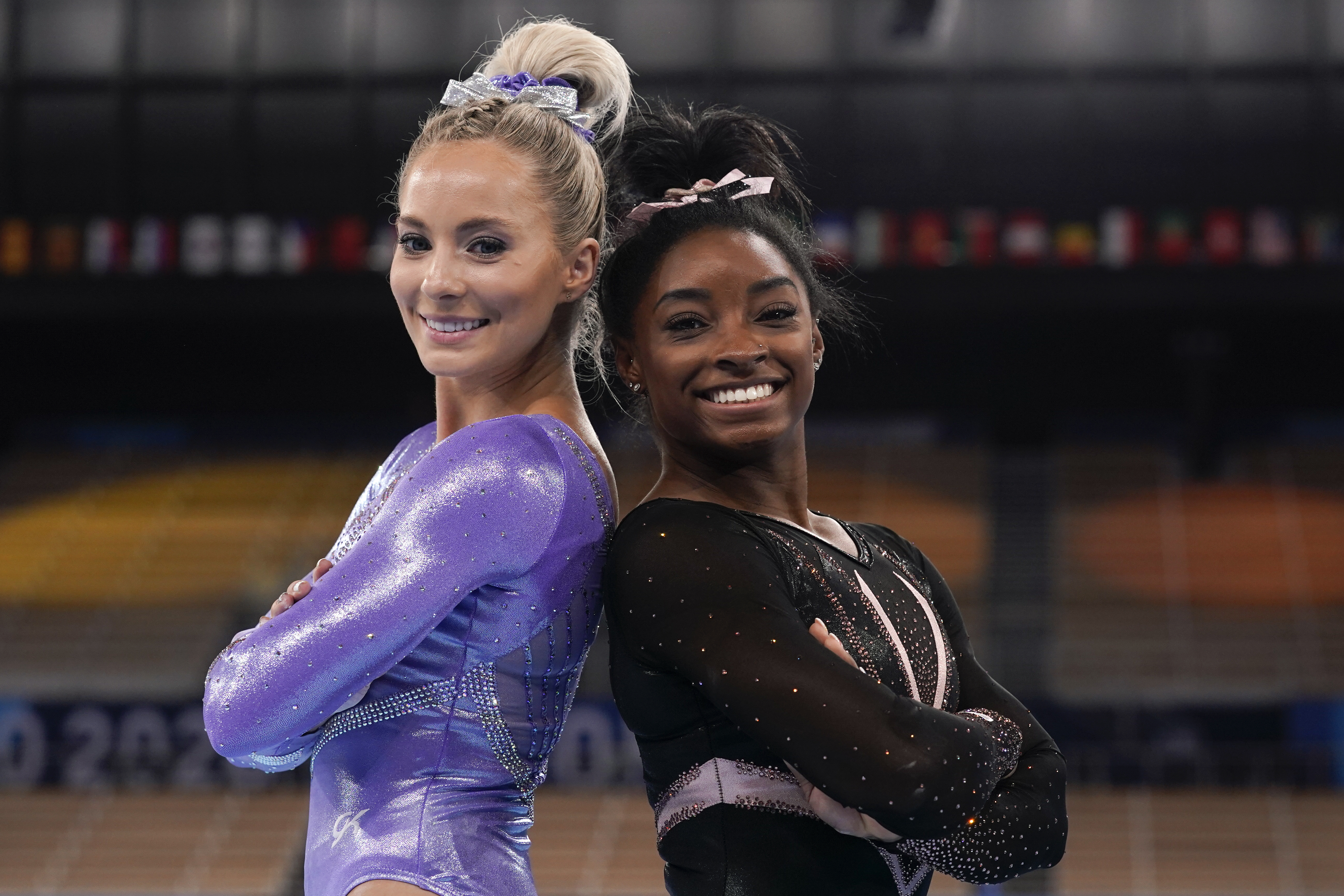 Simone Biles, of the United States, right, poses for pictures with teammate MyKayla Skinner