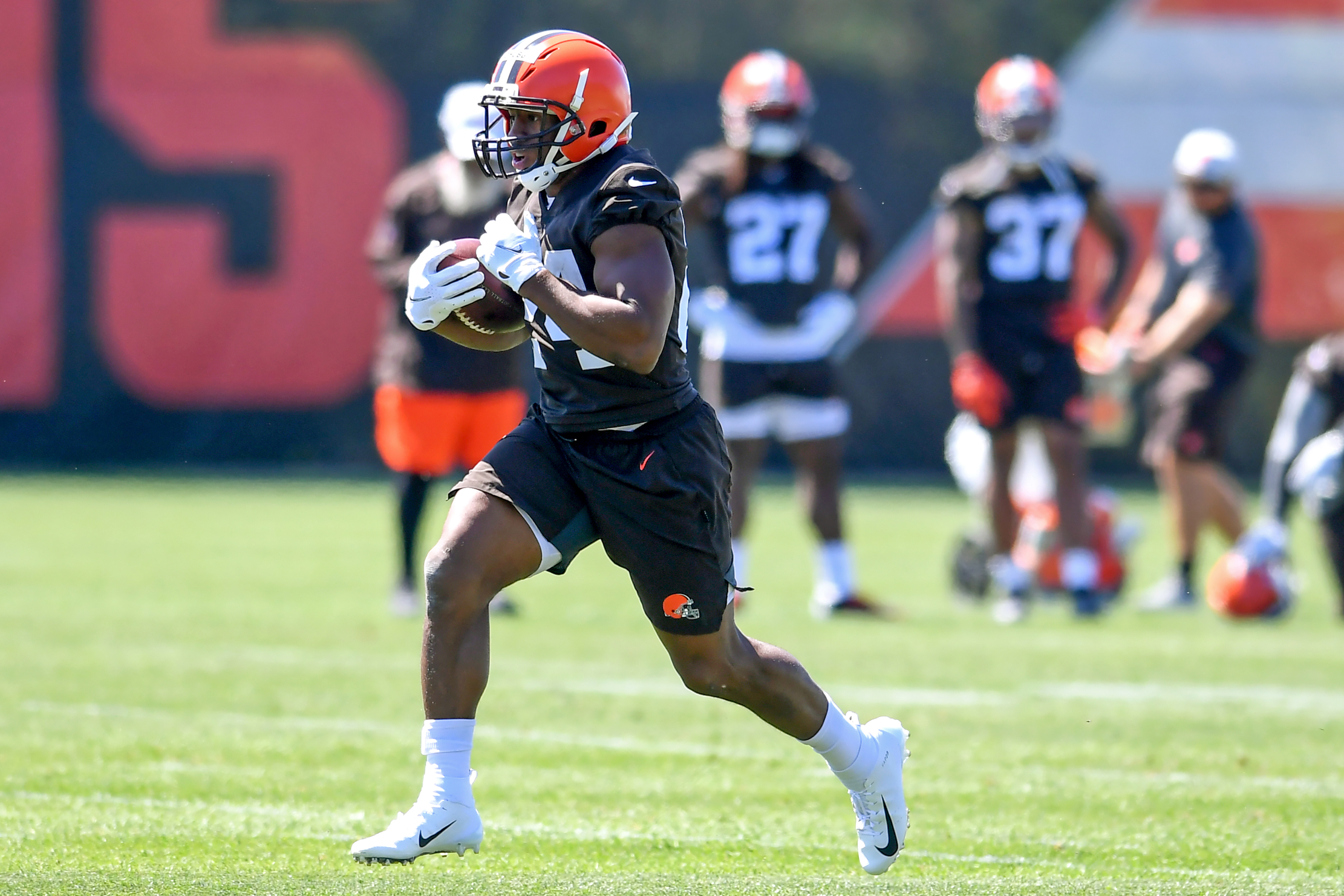 Running back Nick Chubb of the Cleveland Browns carries the ball during a mini camp at the Cleveland Browns training facility on June 16, 2021 in Berea, Ohio.