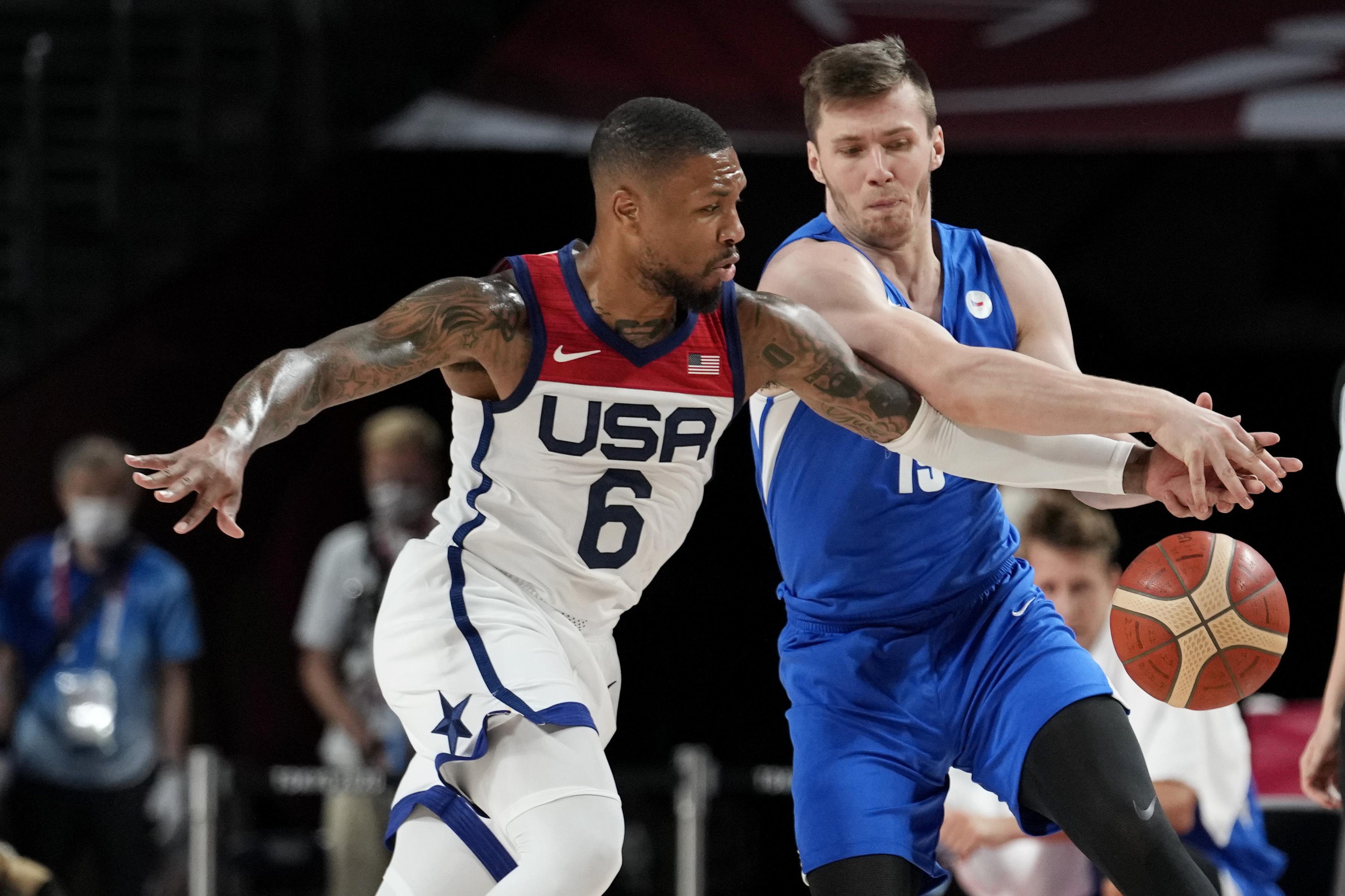 United States's Damian Lillard steals the ball from Czech Republic's Martin Peterka