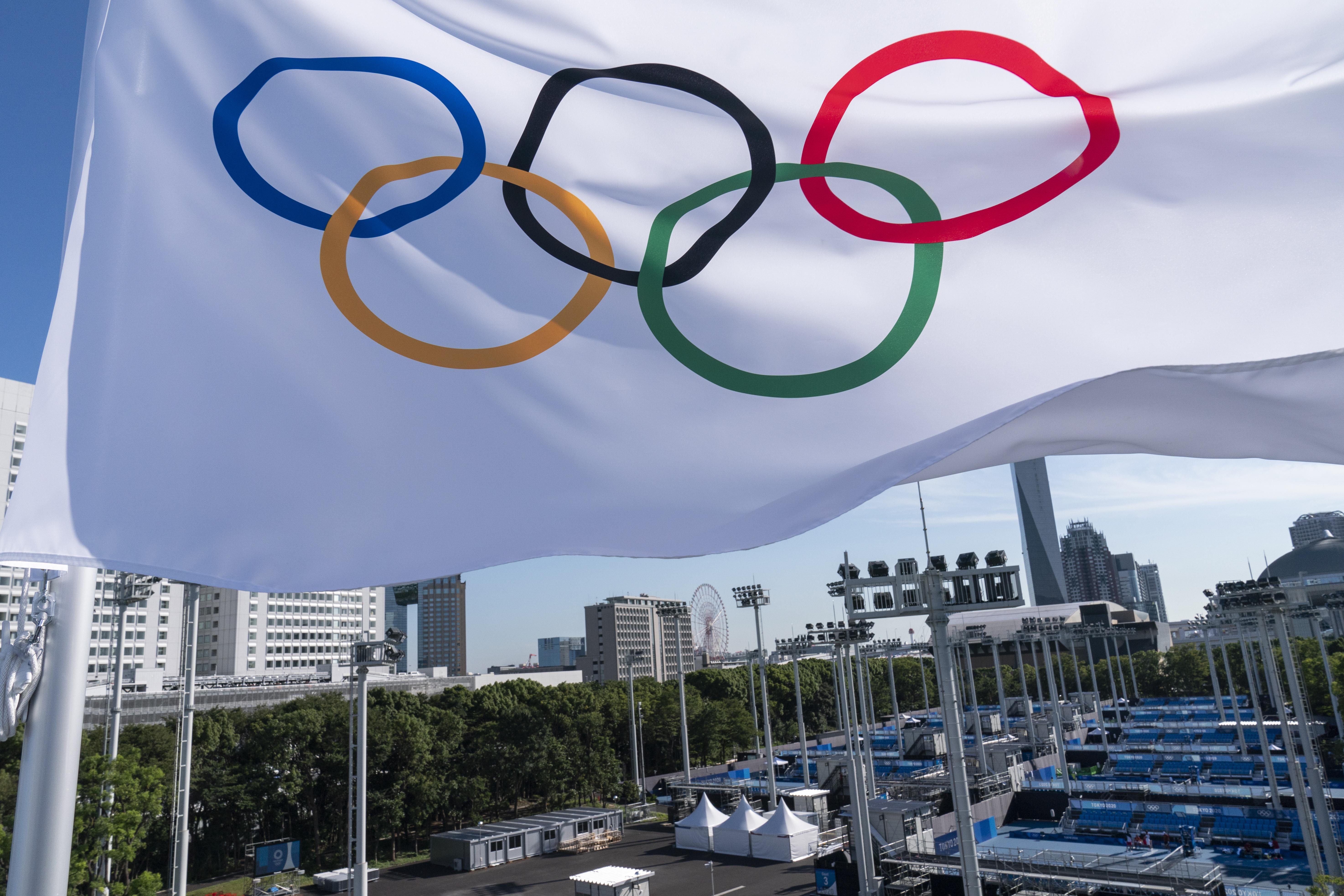 An Olympic flag flies over the the Ariake Tennis Center ahead of the 2020 Summer Olympics.