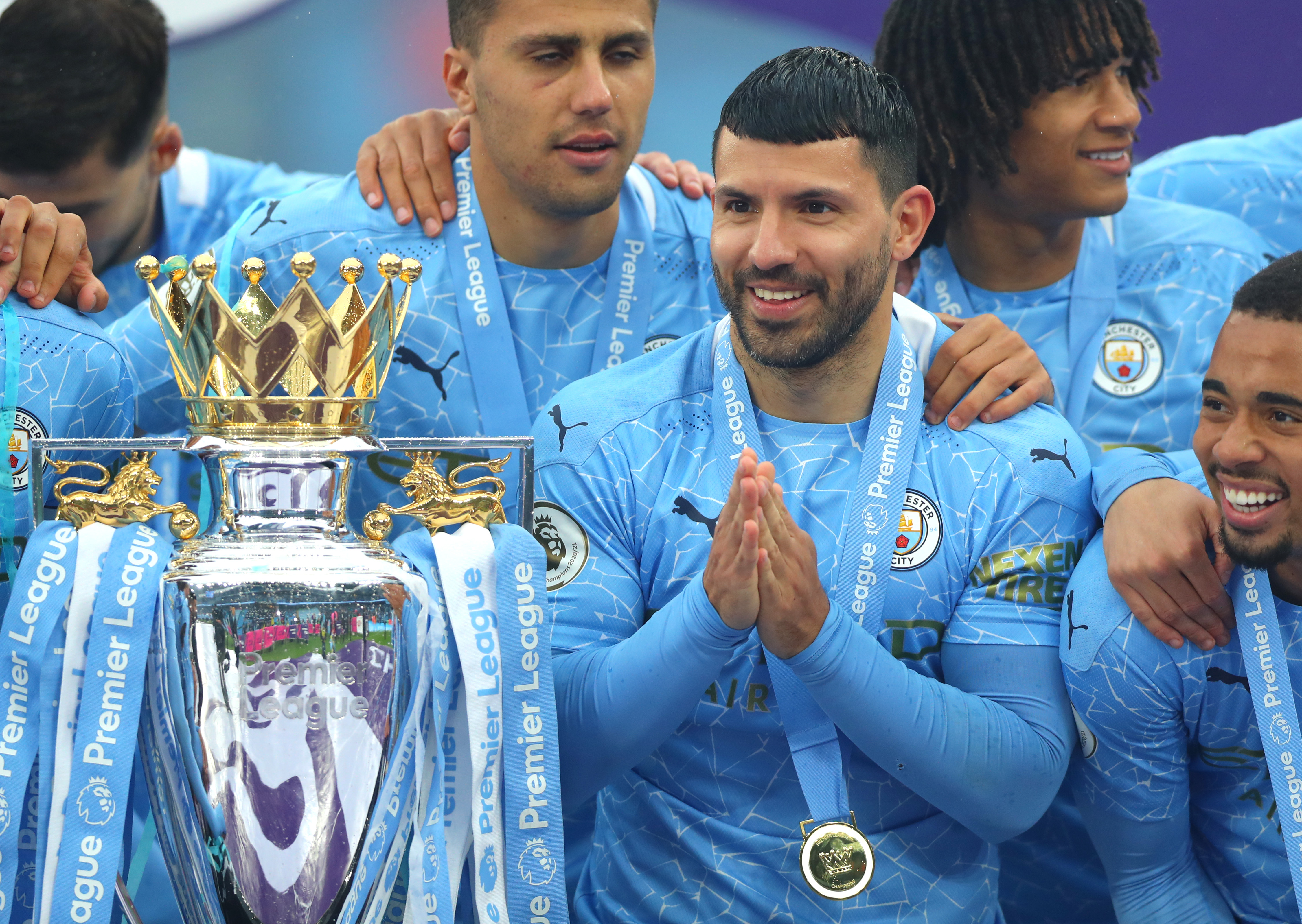 Sergio Aguero with league trophy - Manchester City - Premier League