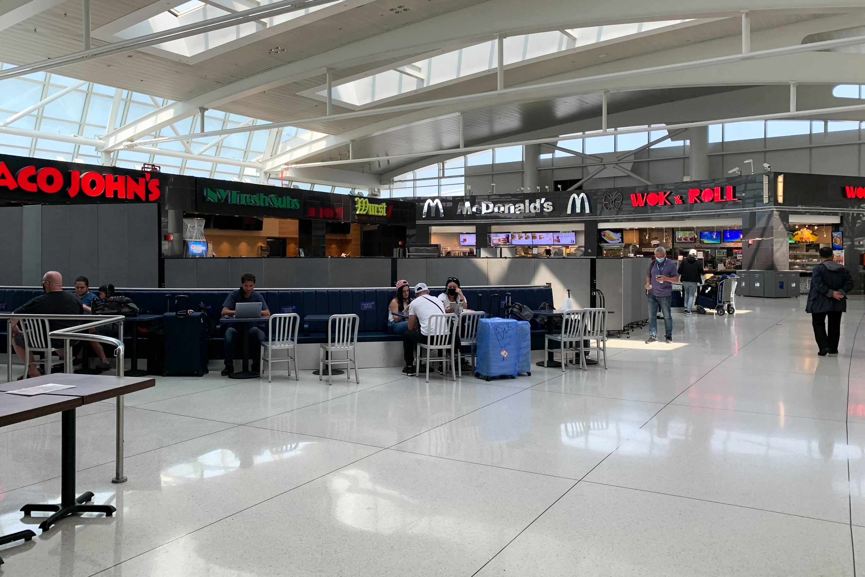 People eat at JFK Airport's Terminal 1, July 27, 2021.
