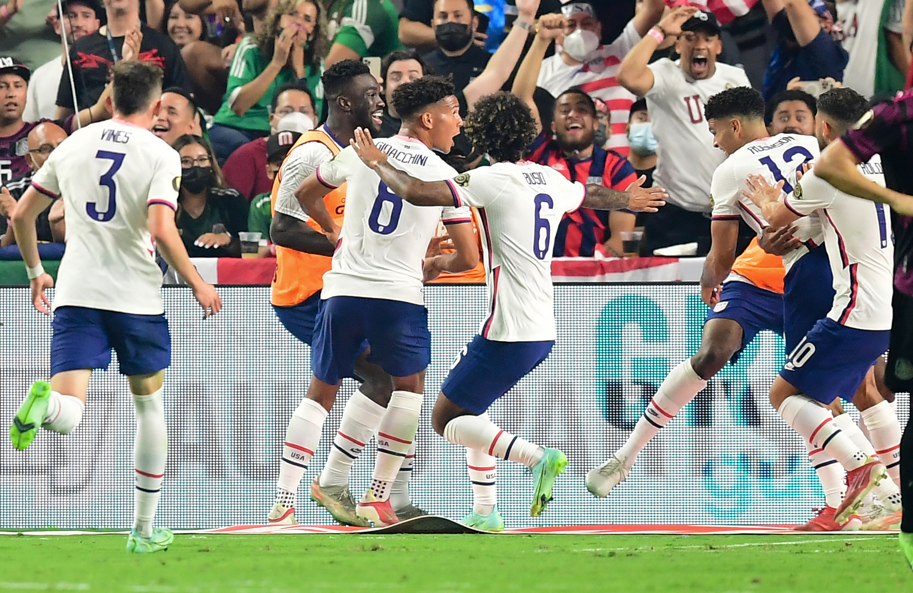 USA team celebrates after USA's defender Miles Robinson scored during the Concacaf Gold Cup football match final between Mexico and USA at the Allegiant stadium in Las Vegas, Nevada on August 1, 2021.