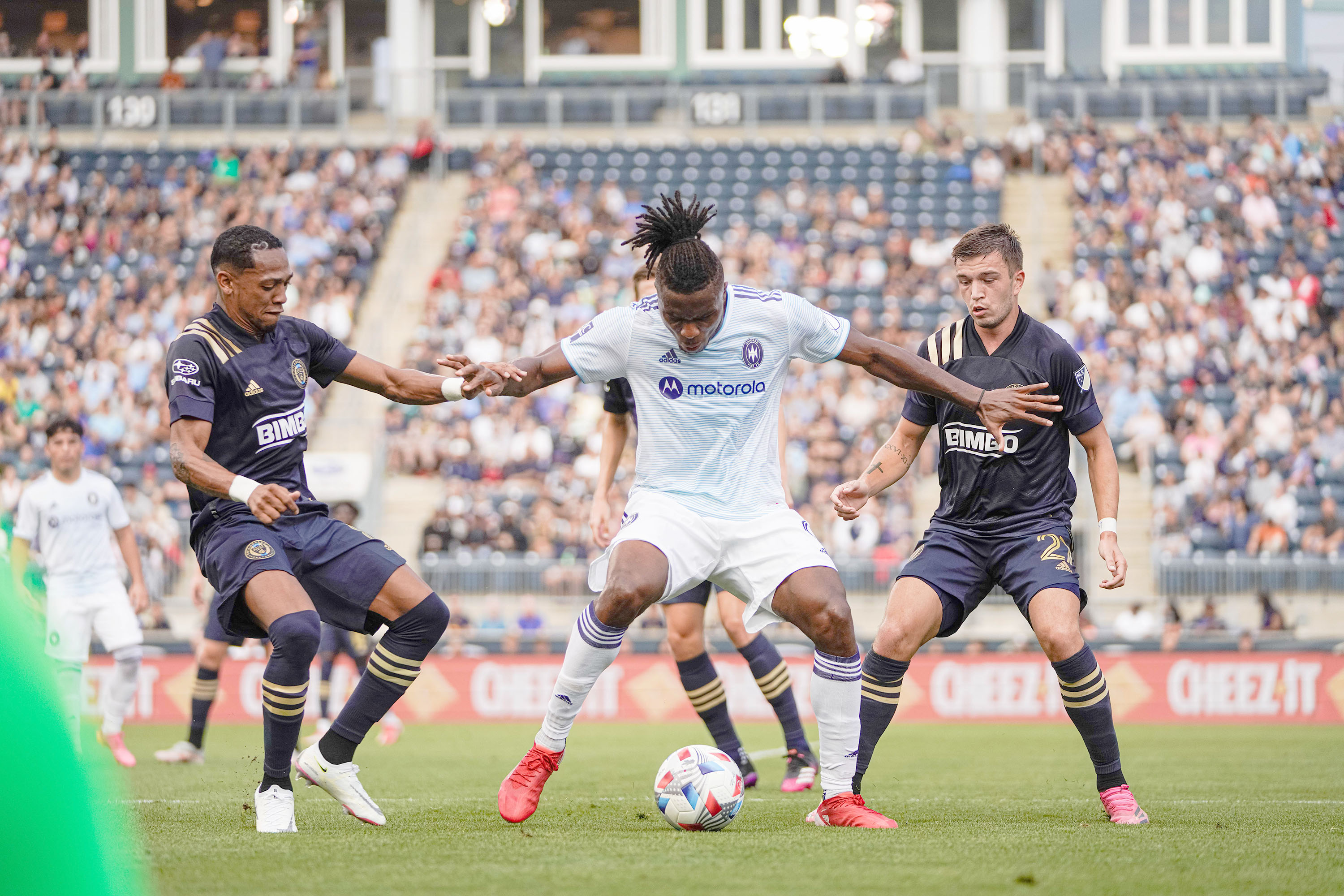 The Fire's Chinonso Offor (center) holds off the Union's Jose Martinez (left) and Kai Wagner.