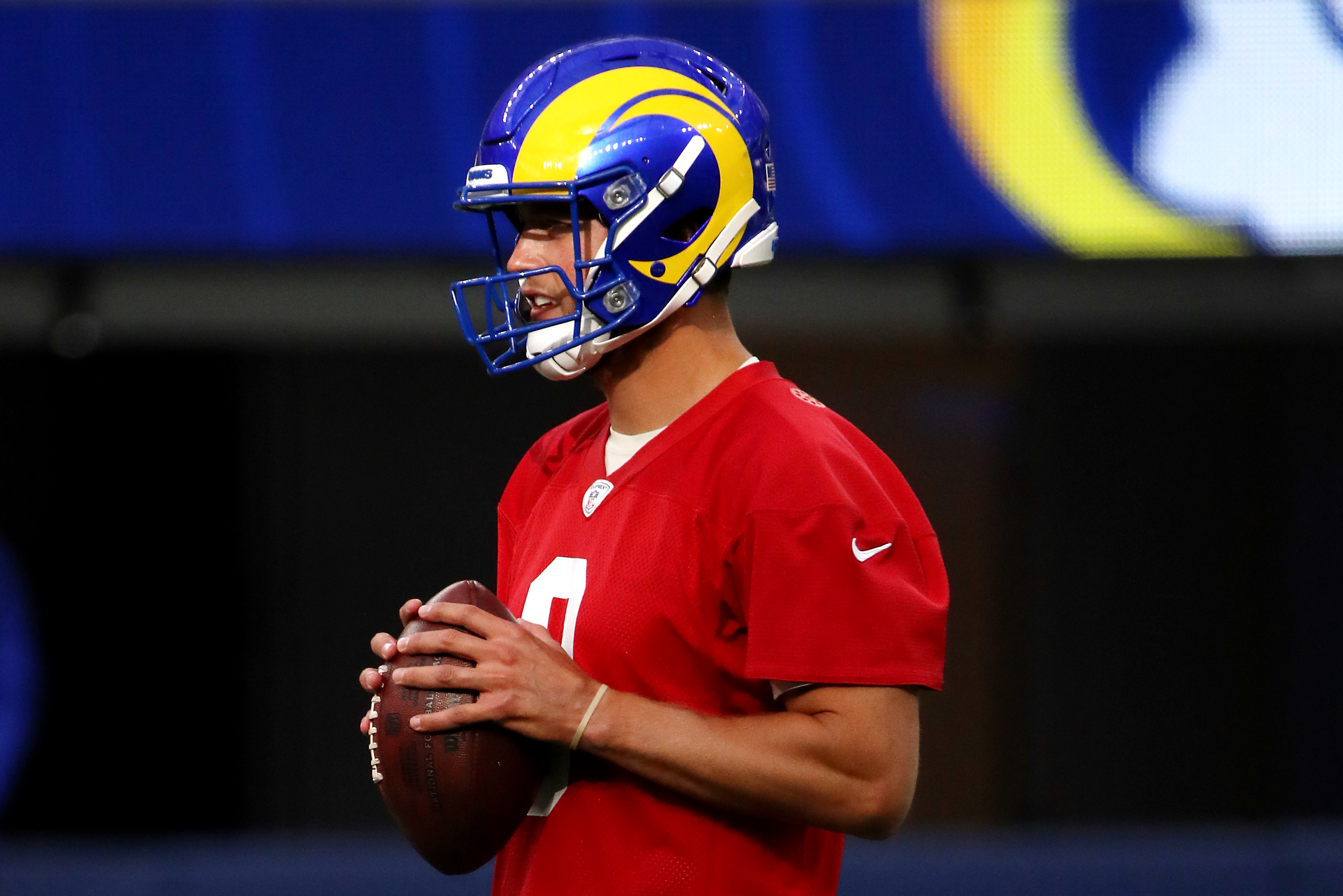 Matthew Stafford #9 of the Los Angeles Rams handles the ball during open practice at SoFi Stadium on June 10, 2021 in Inglewood, California.