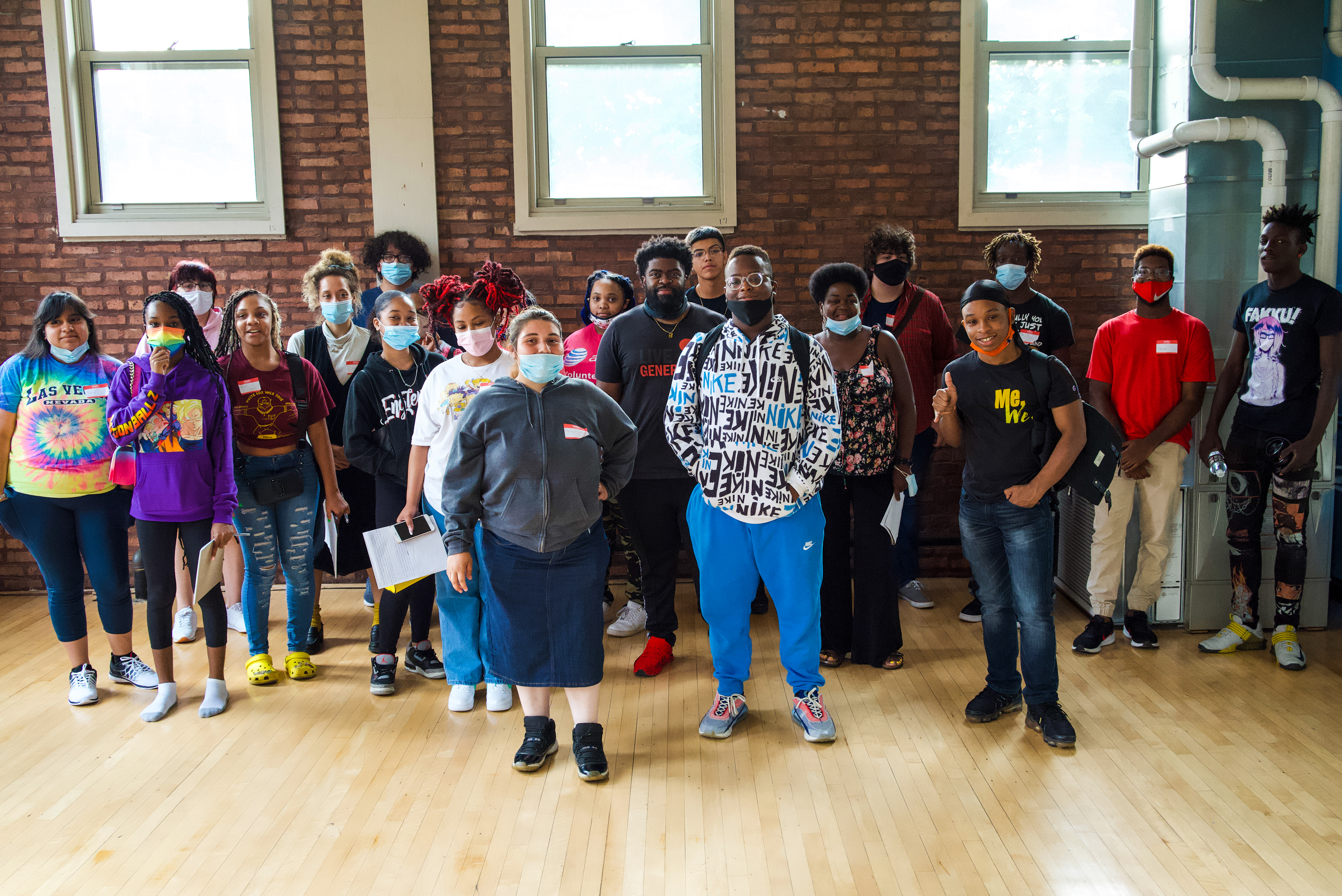 Participants of Chicago Stories on the Block gather around guest speaker Simeon Frierson (center) from Free Spirit Media.