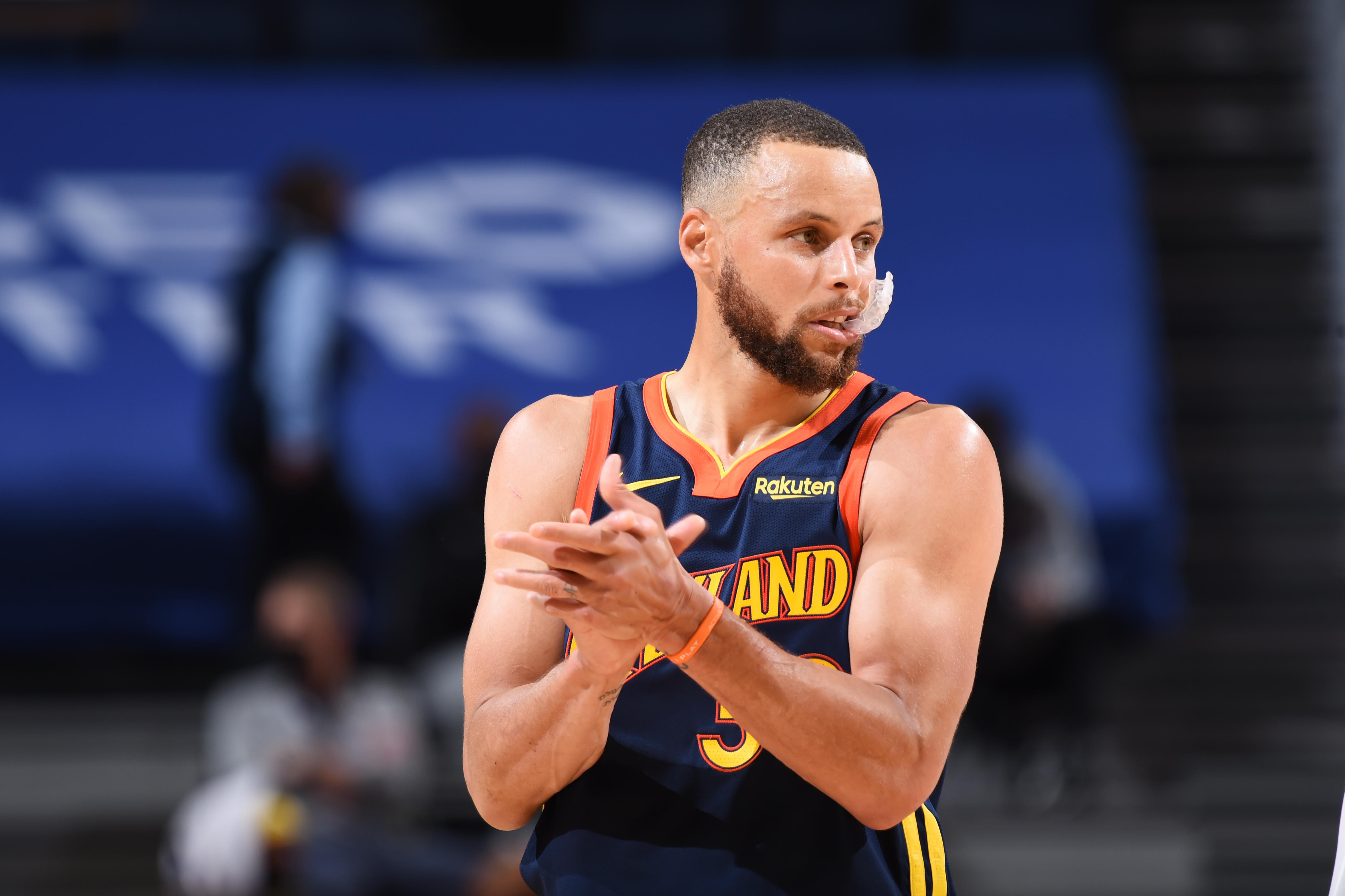Stephen Curry of the Golden State Warriors claps during the game against the Memphis Grizzlies during the 2021 Play-In Tournament on May 21, 2021 at Chase Center in San Francisco, California.