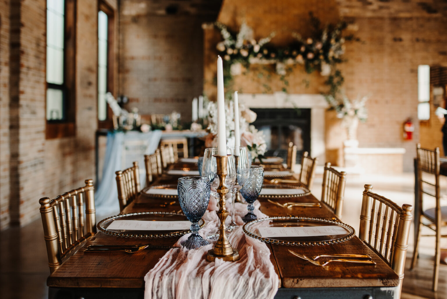 A long wooden table laid for a wedding.