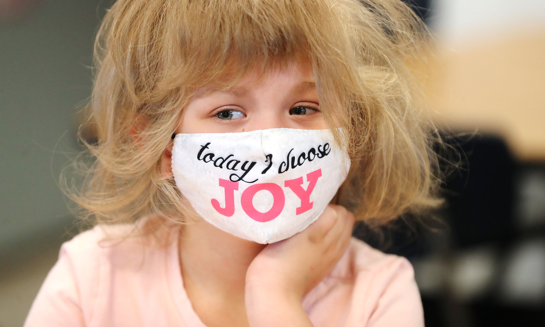 Kindergartner Arya Cardinelle wears a mask in class at Woodrow Wilson Elementary Schoolin Salt Lake City.