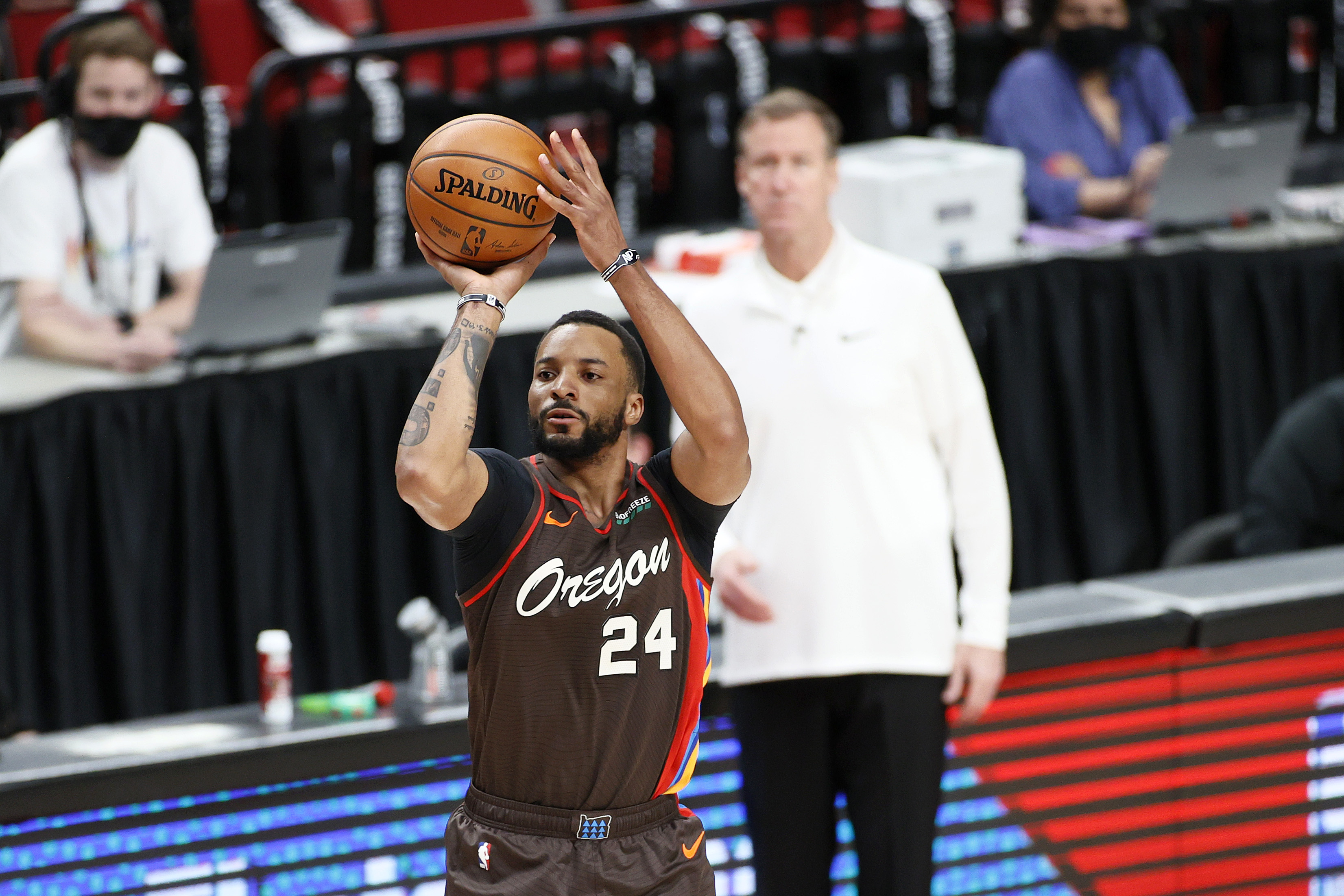 Norman Powell #24 of the Portland Trail Blazers attempts a three point basket against the Denver Nuggets during Round 1, Game 6 of the 2021 NBA Playoffs at Moda Center on June 03, 2021 in Portland, Oregon.