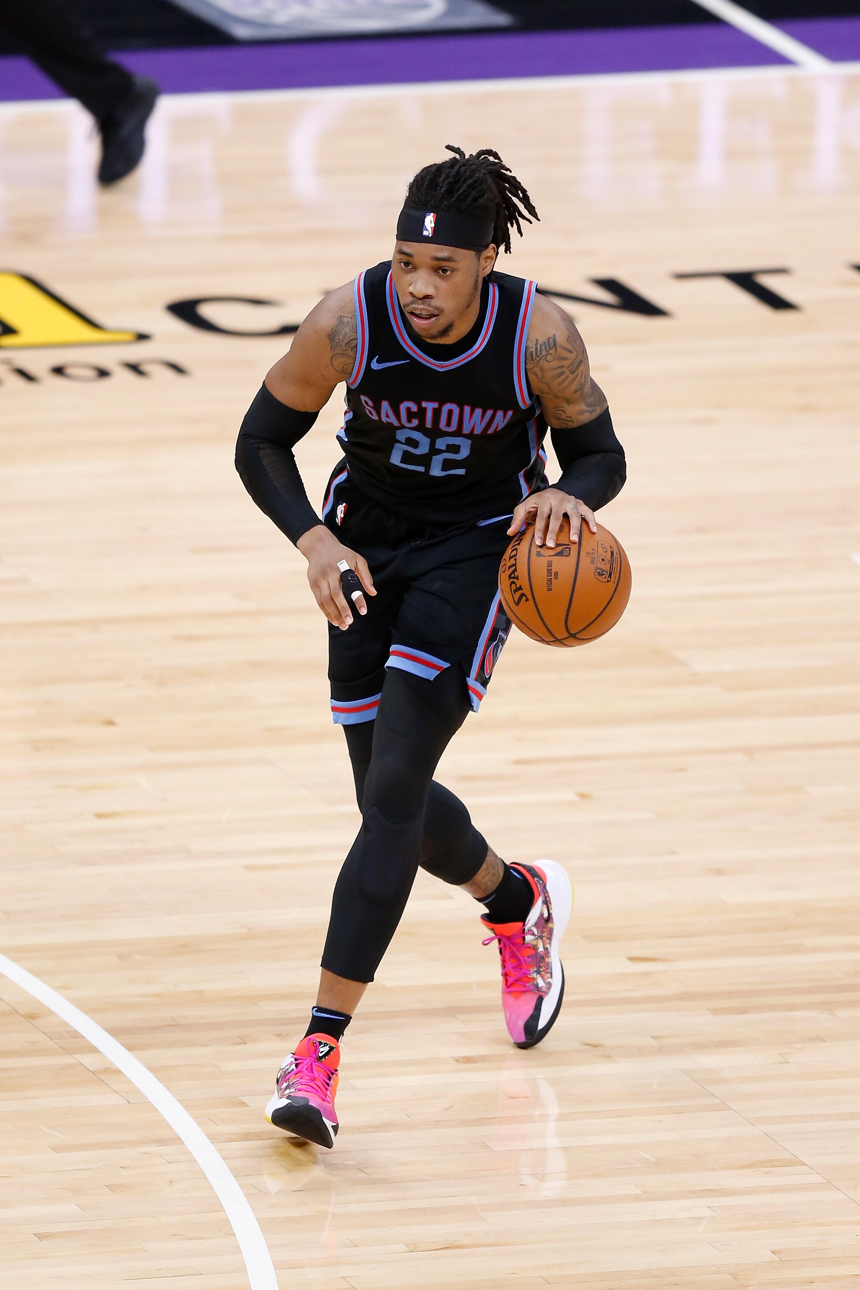 Richaun Holmes #22 of the Sacramento Kings dribbles the ball against the Oklahoma City Thunder at Golden 1 Center on May 11, 2021 in Sacramento, California.