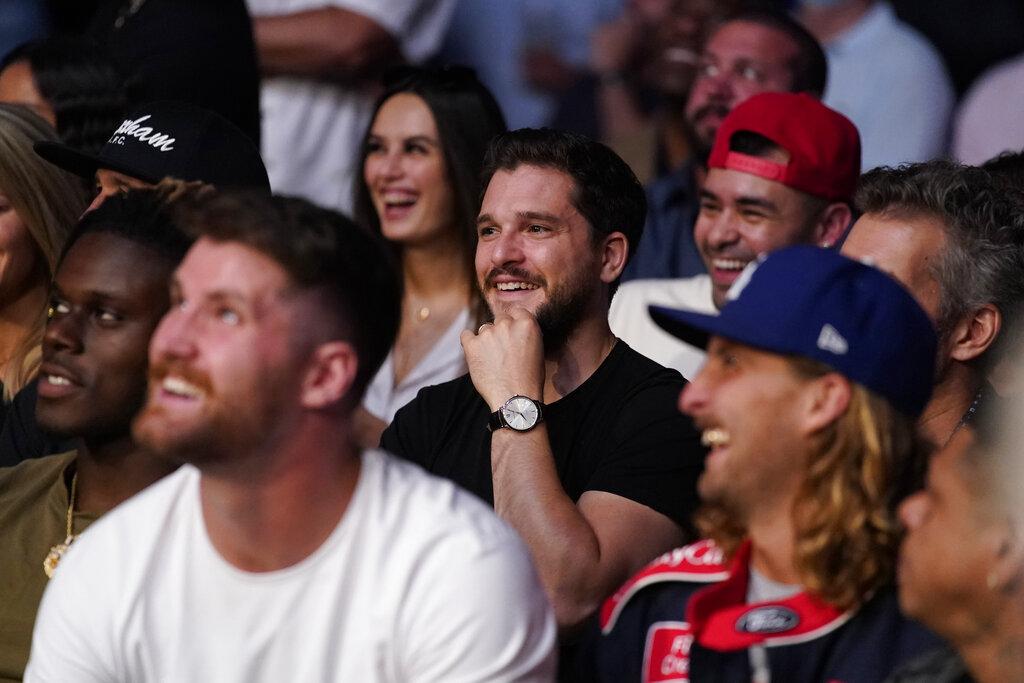 Actor Kit Harington watches as Irene Aldana fights Yana Kunitskaya in a UFC 264 event.