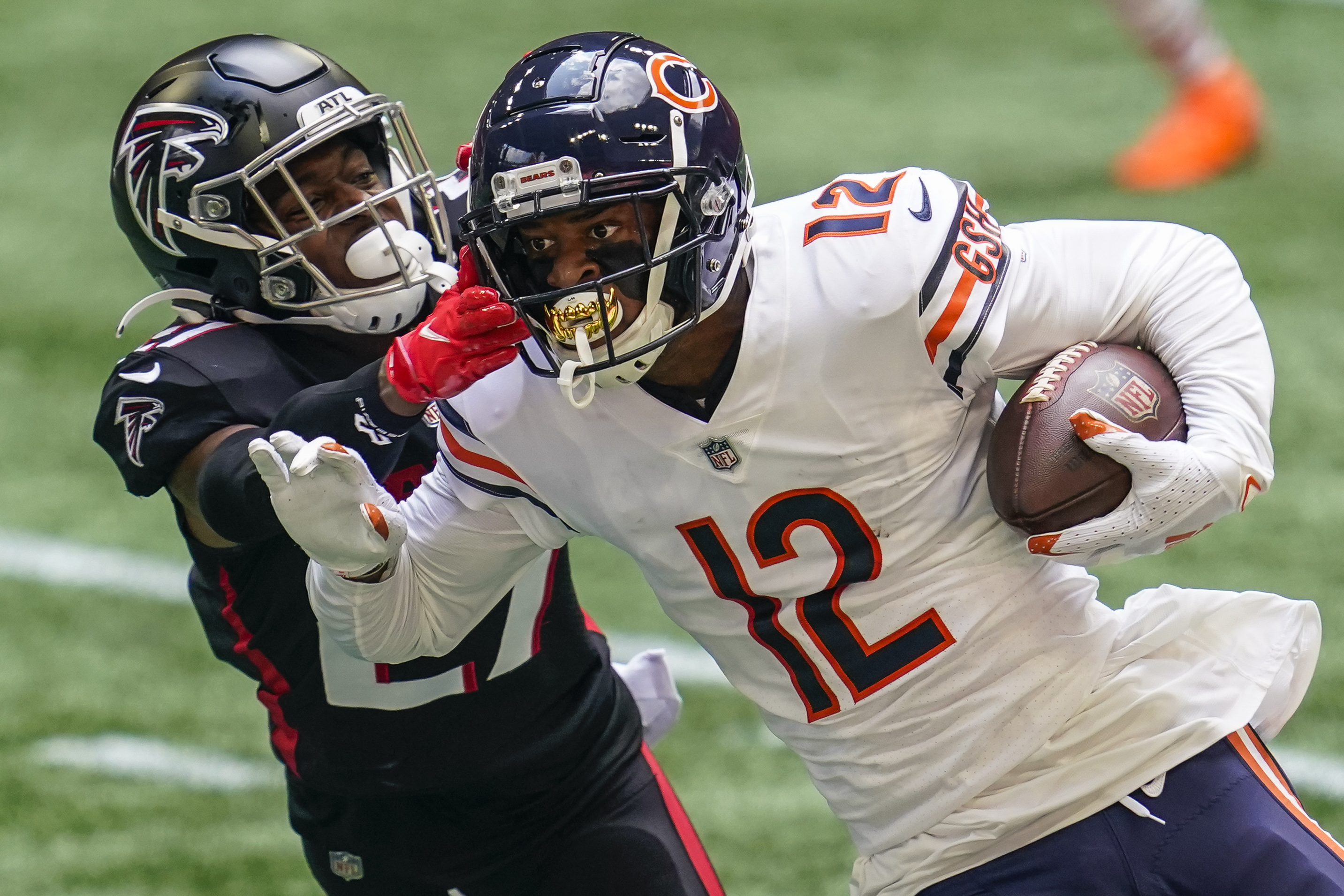 Chicago Bears wide receiver Allen Robinson II (12) runs against Atlanta Falcons safety Damontae Kazee (27) during the first half at Mercedes-Benz Stadium.