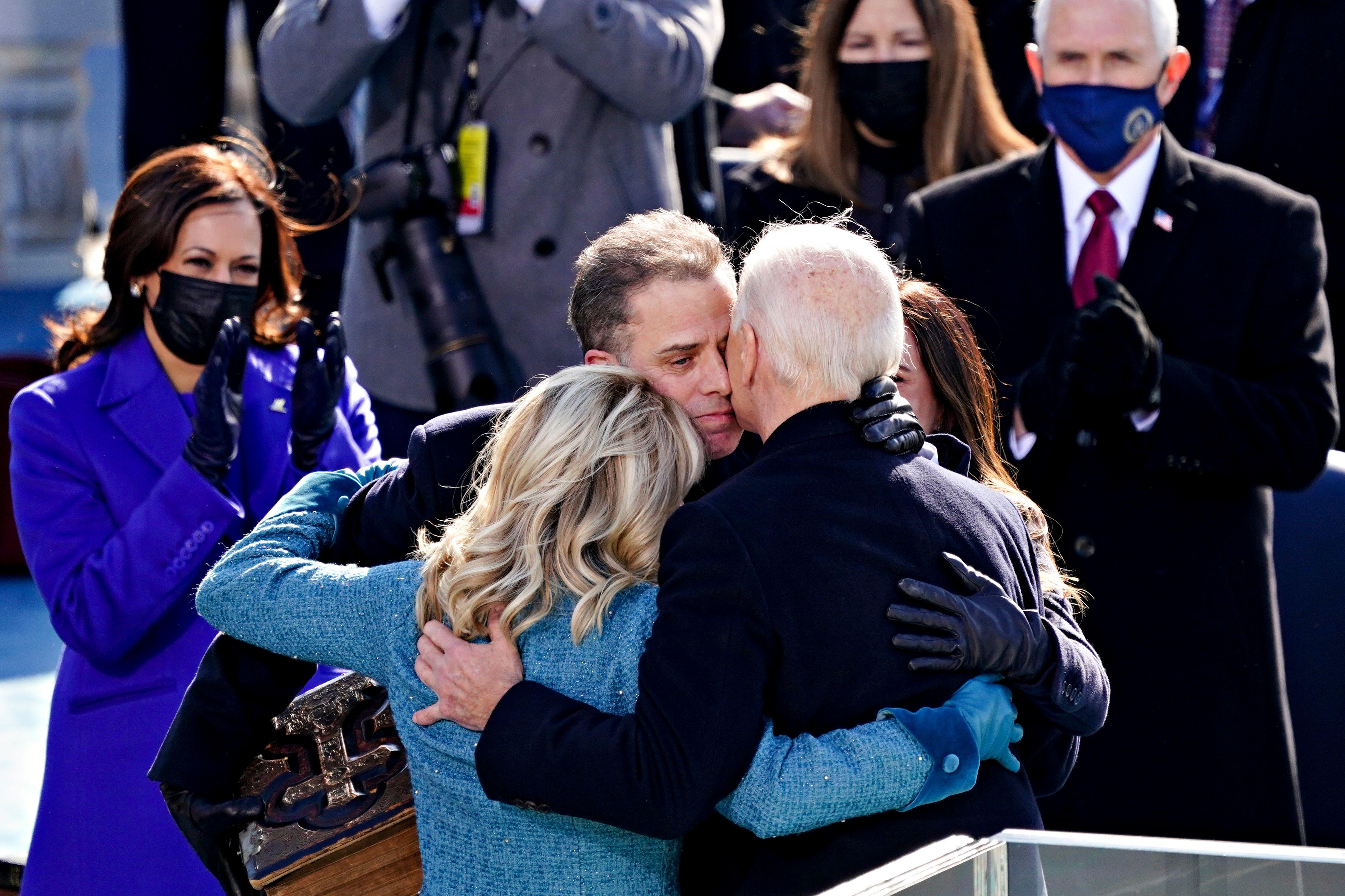Jill and Joe Biden in a hug with Hunter Biden.