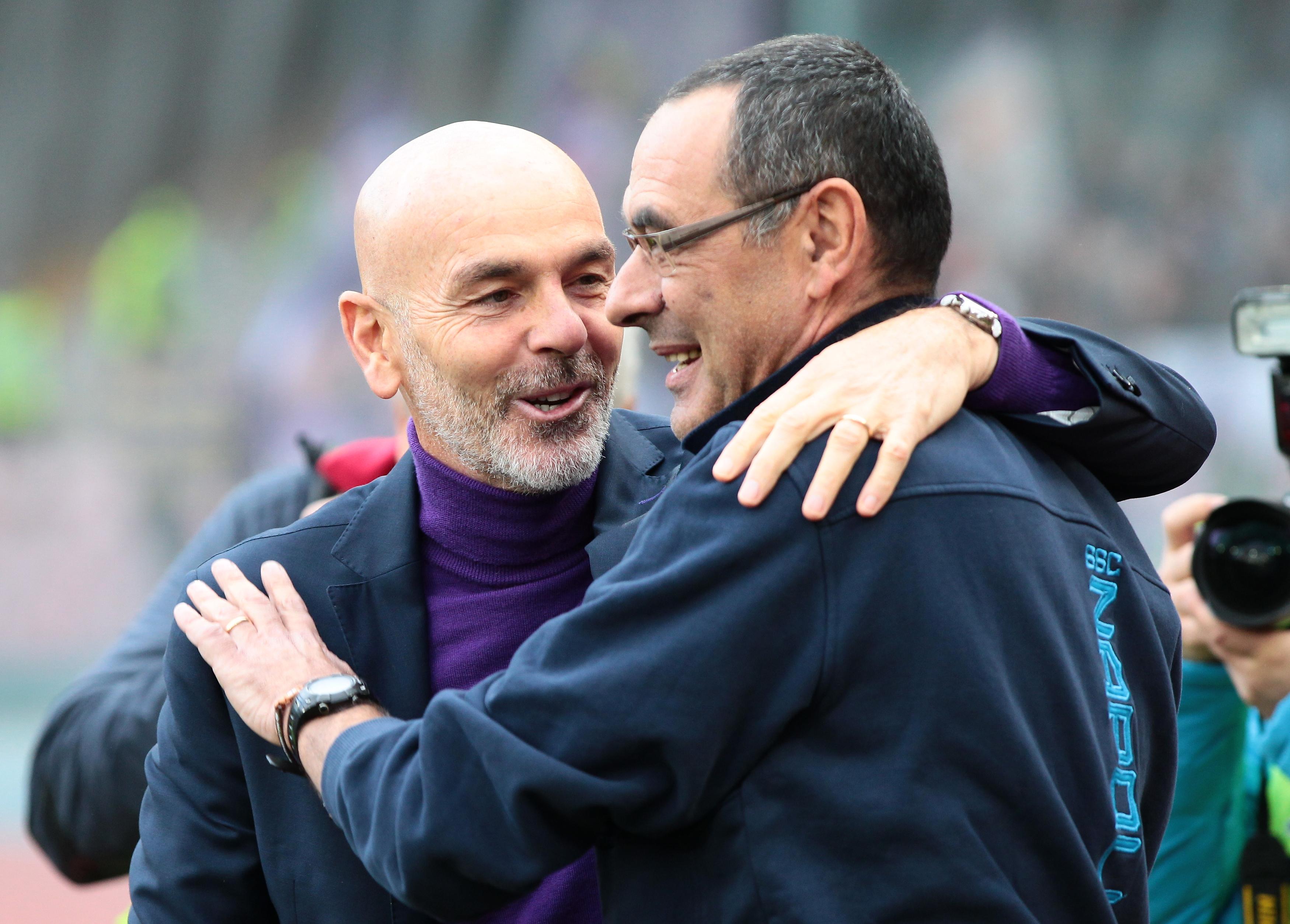 Fiorentina's Italian coach Stefano Pioli greets Napoli's...