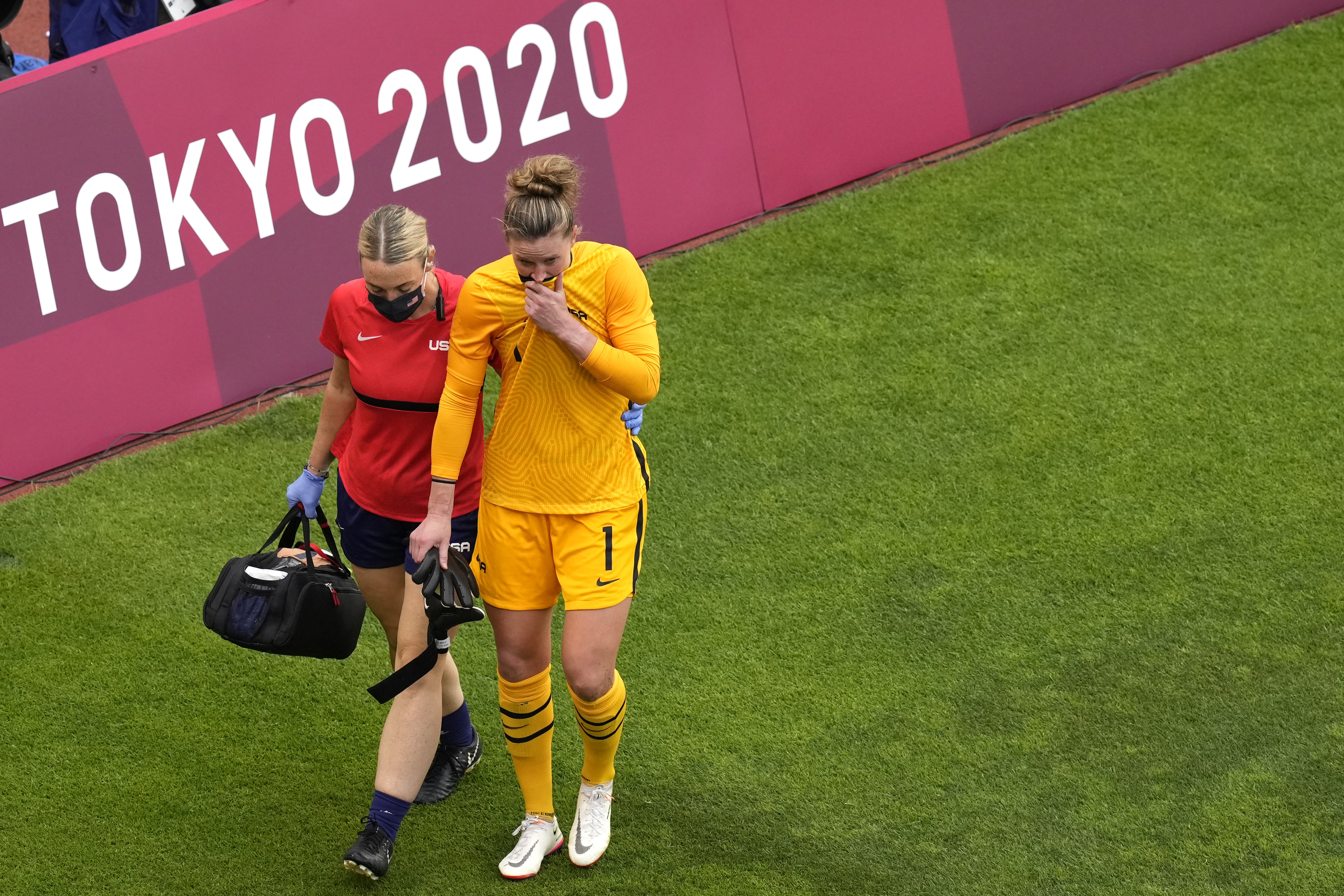 United States' goalkeeper Alyssa Naeher leaves the field after being injured during the semifinal match against Canada on Monday.