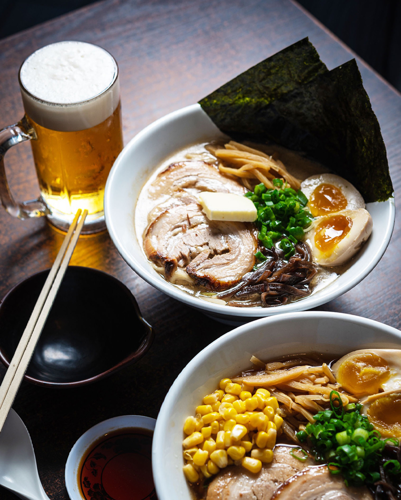 A table filled with Tonkotsu ramen bowls and beer, on the Monta Chaya menu in Henderson.