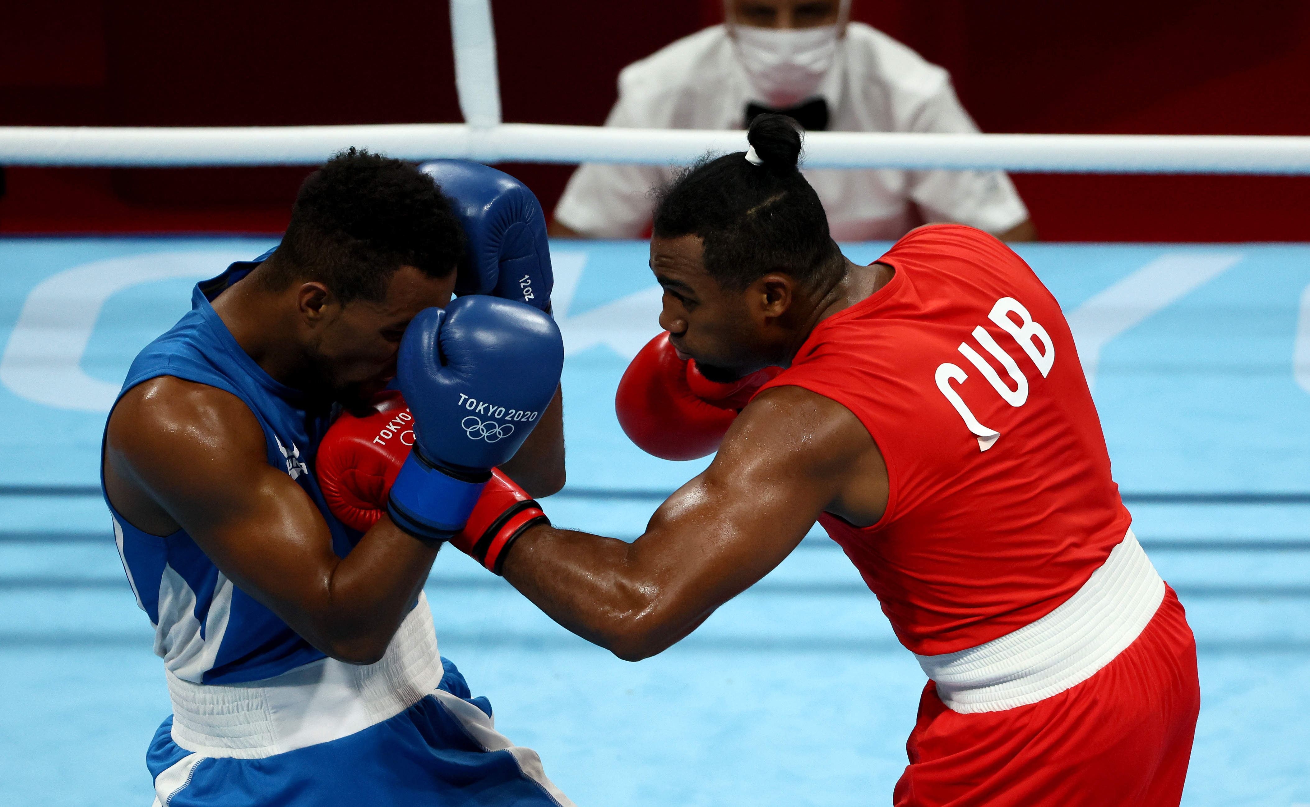Arlen Lopez (red) of Team Cuba exchanges punches with Loren Berto Alfonso Dominguez of Team Azerbaijan during the Men's Light Heavy (75-81kg) semi final on day nine of the Tokyo 2020 Olympic Games at Kokugikan Arena on August 01, 2021 in Tokyo, Japan.