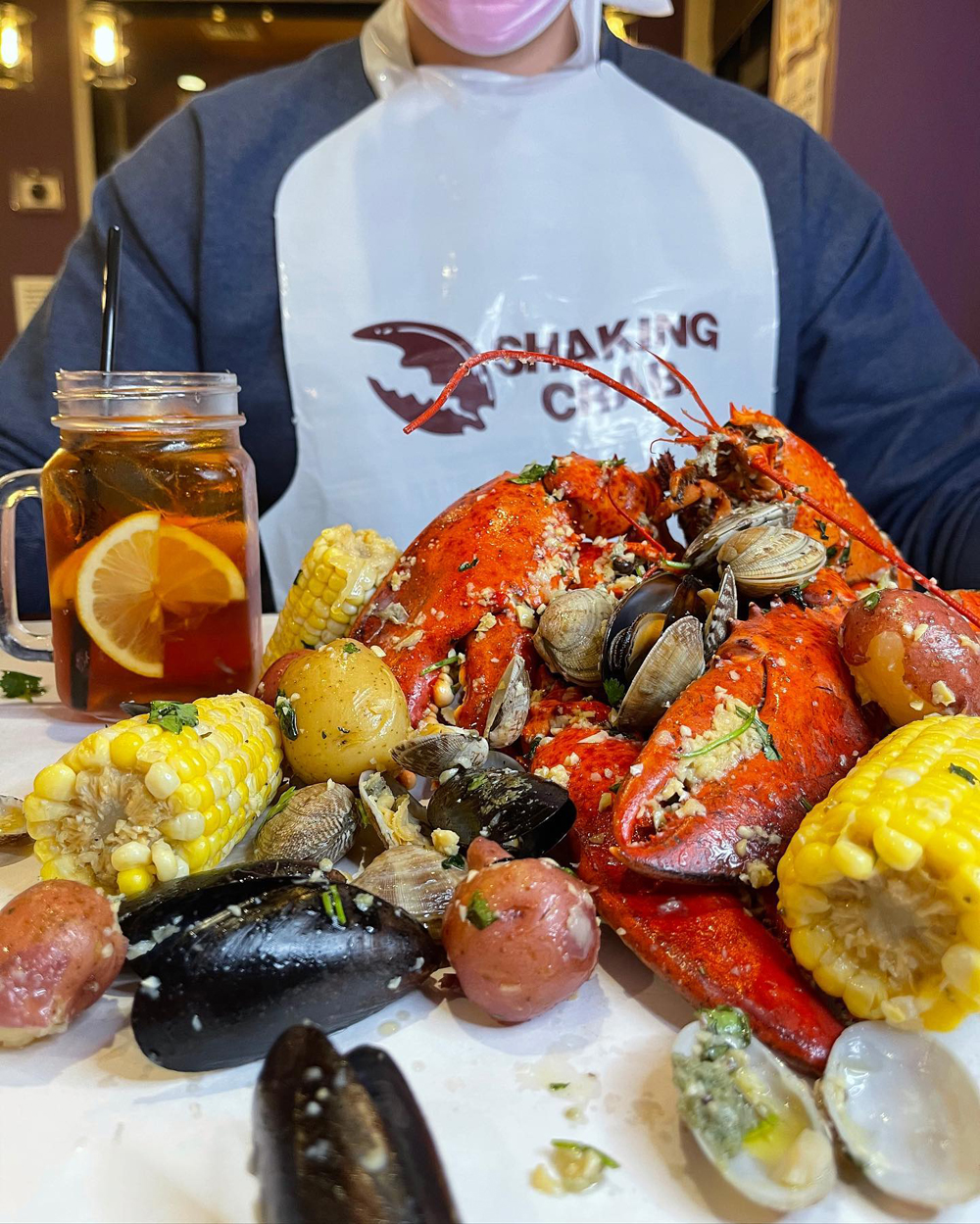 A meal of crab, potatoes, corn, mussels and clams at Shaking Crab from New England.