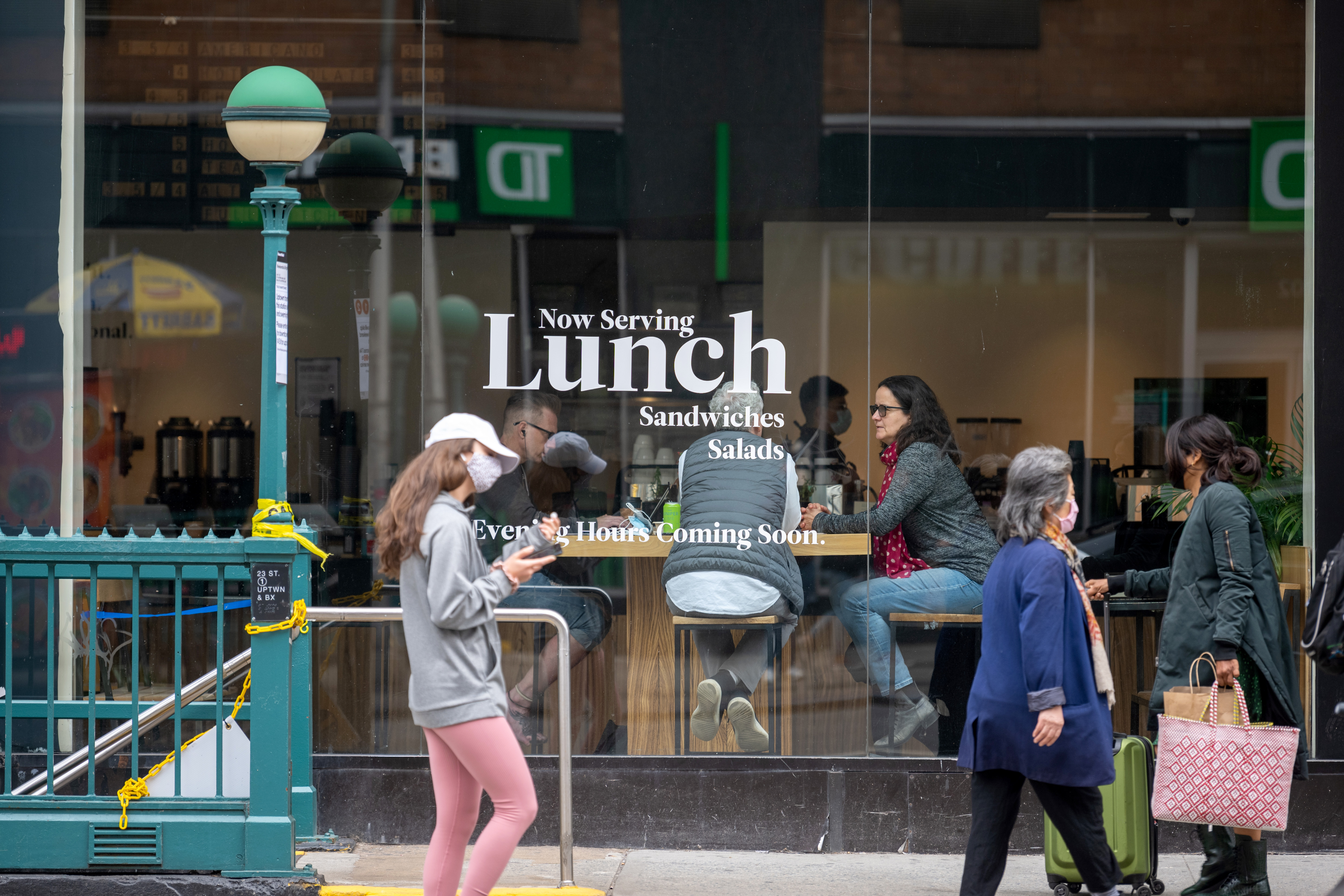 New Yorkers on a city street and inside a restaurant.