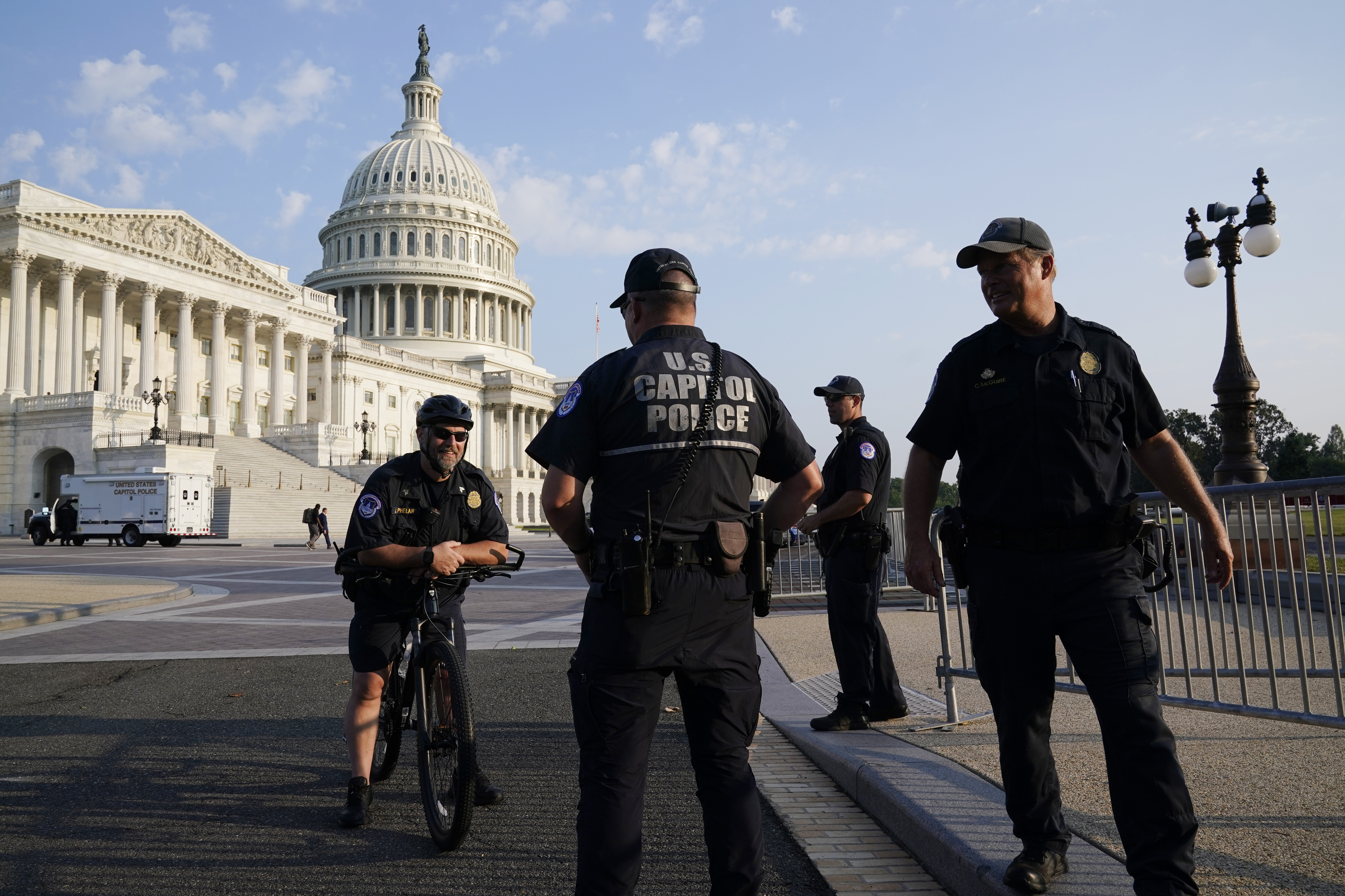 The U.S. Capitol is seen in Washington, early Tuesday, July 27, 2021, as U.S. Capitol Police keep eyes on the perimeter.