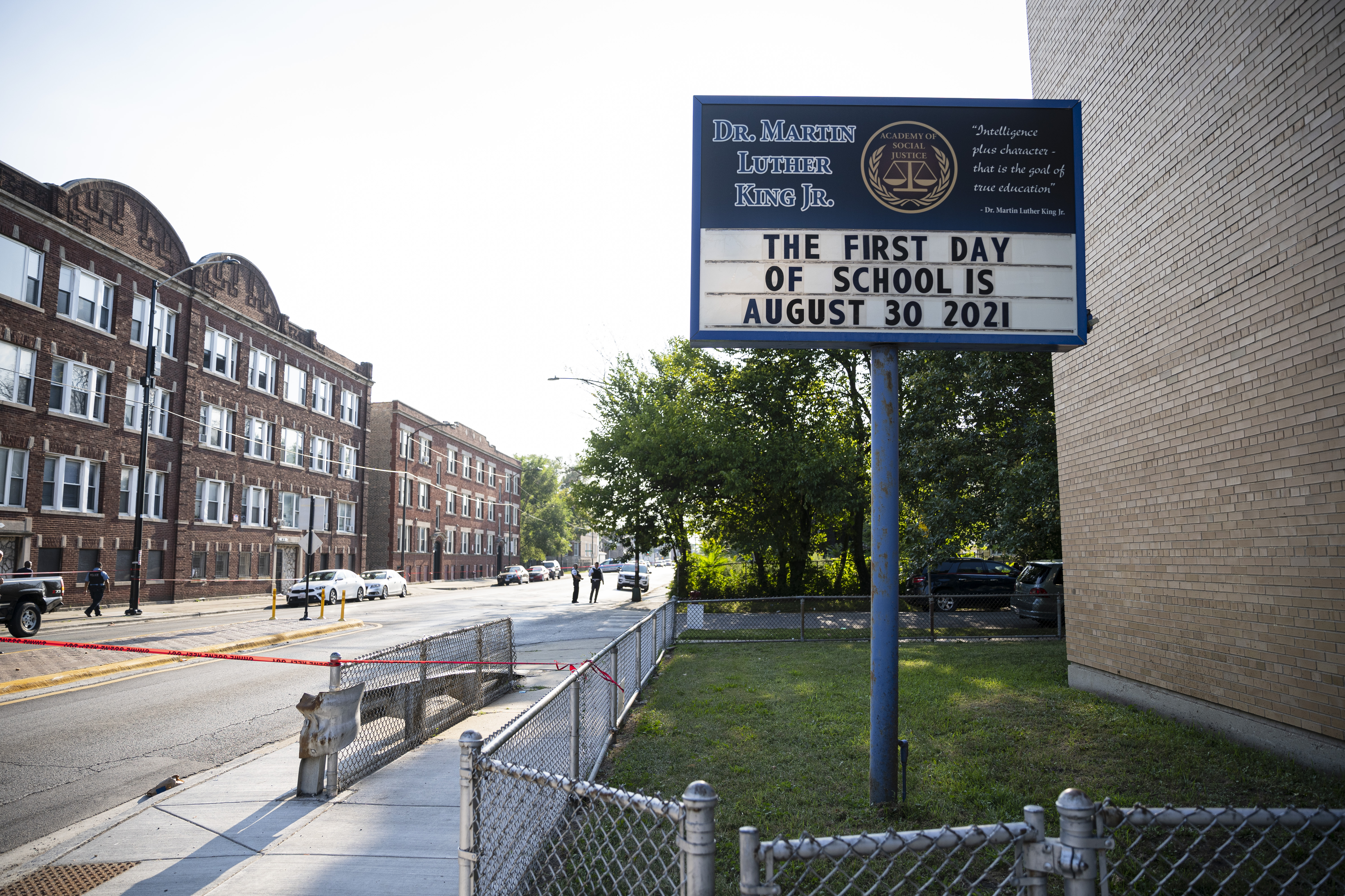 Police investigate the scene where a 16-year-old was shot near S Union and W 71st St in Englewood, Tuesday, Aug. 3, 2021.