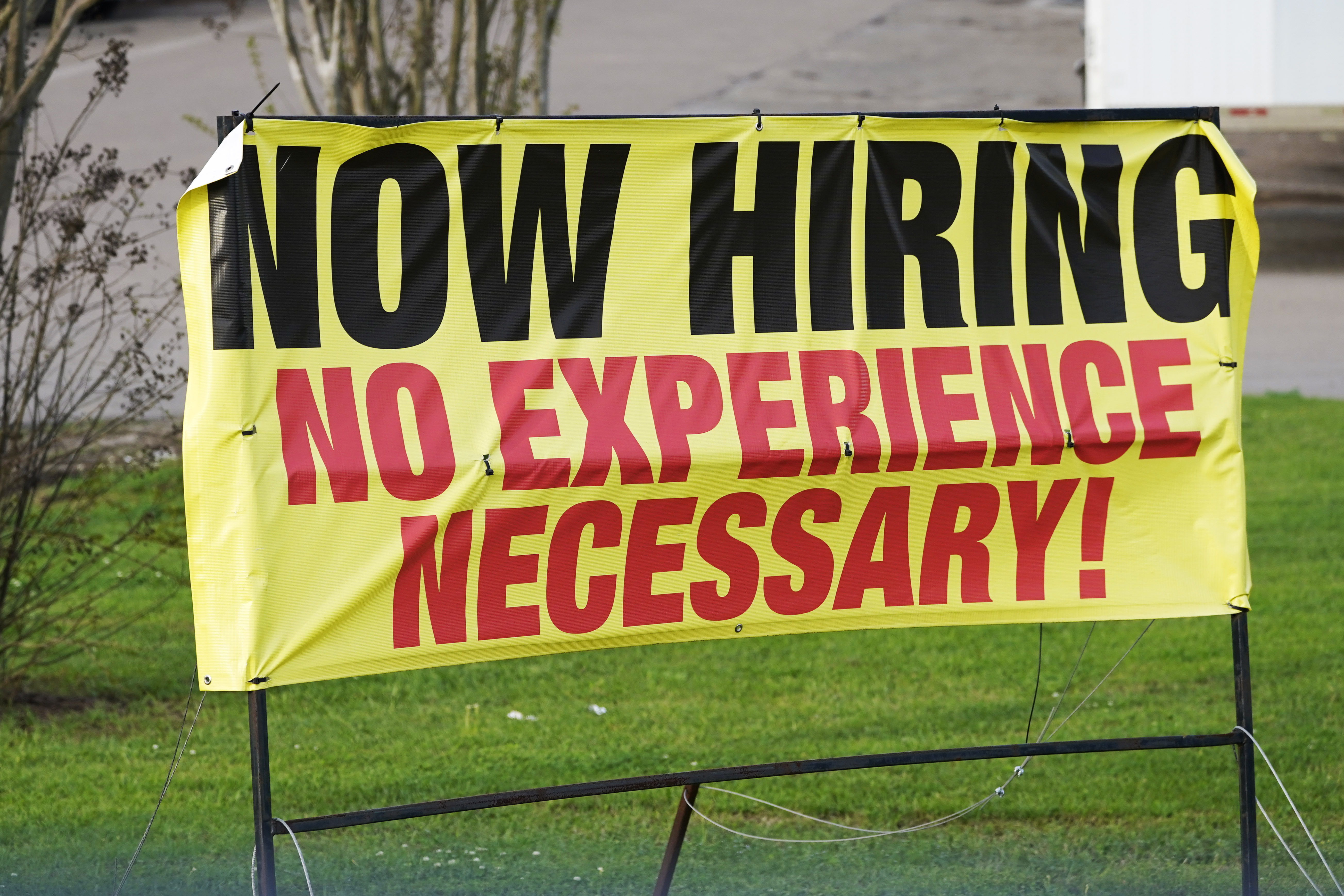 A roadside banner beckons potential employees outside a company in Hattiesburg, Miss., on March 27, 2021.